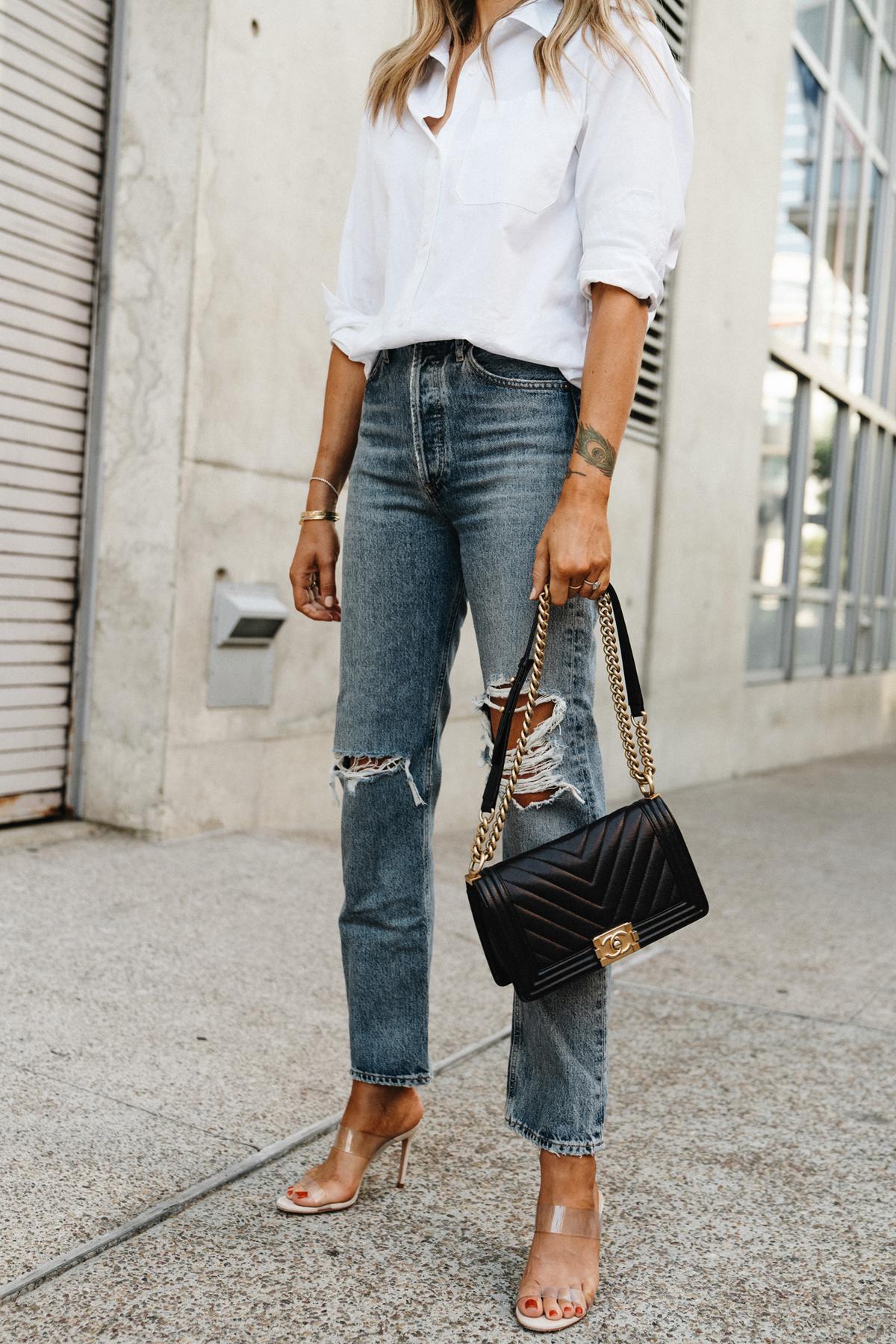 Fashion Jackson Wearing Jenni Kayne White Button Up Shirt AGOLDE Ripped Jeans Chanel Black Boy Bag Schutz Clear Heeled Sandals