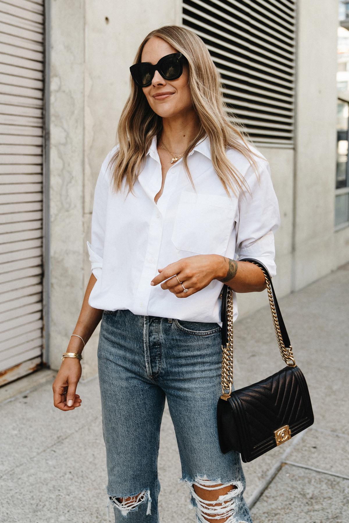 Fashion Jackson Wearing Jenni Kayne White Button Up Shirt AGOLDE Ripped Jeans Chanel Black Boy Bag