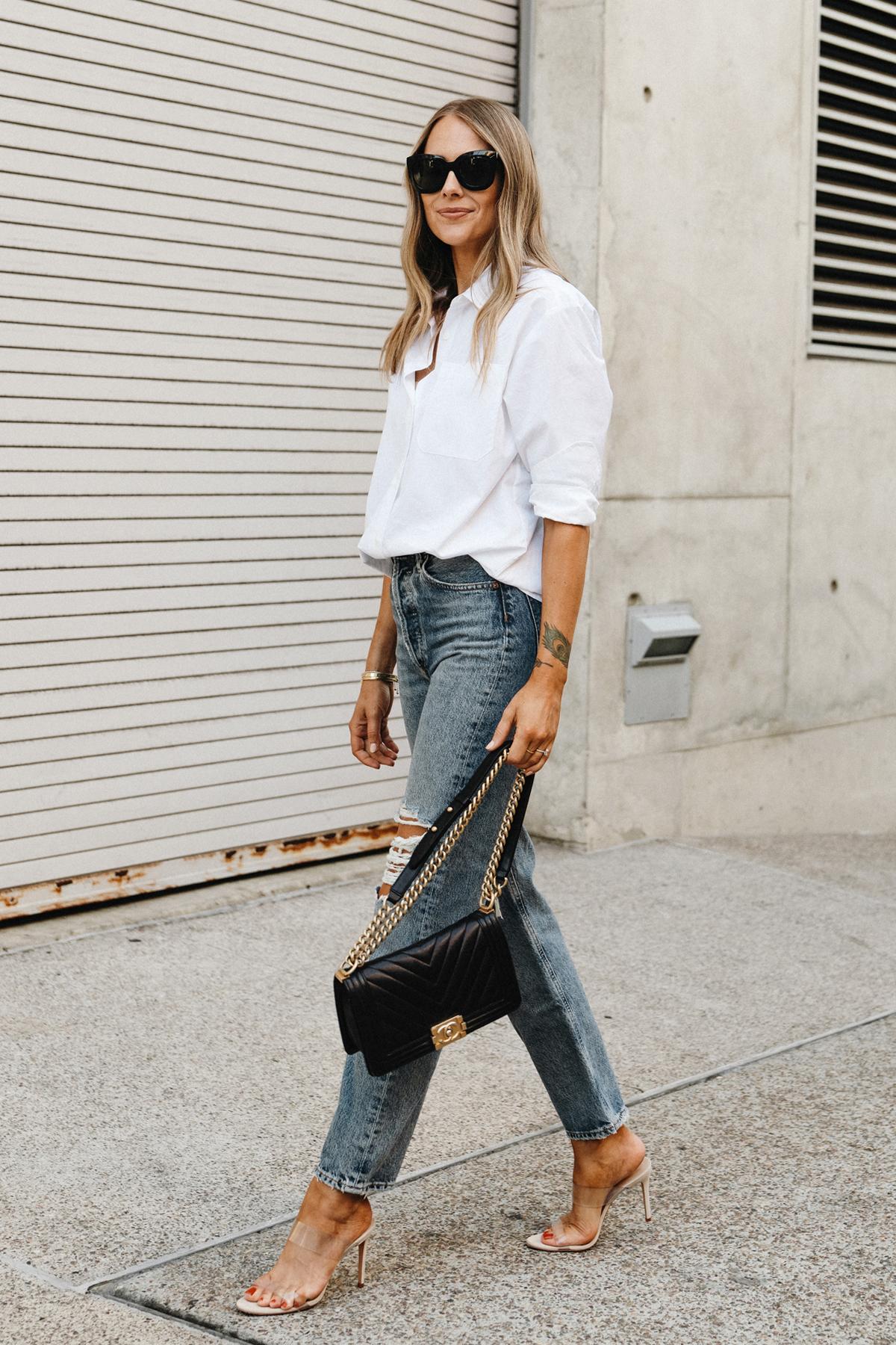 Fashion Jackson Wearing Jenni Kayne White Button Up Shirt AGOLDE Ripped Jeans Schutz Clear Heeled Sandals Chanel Black Boy Bag Street Style