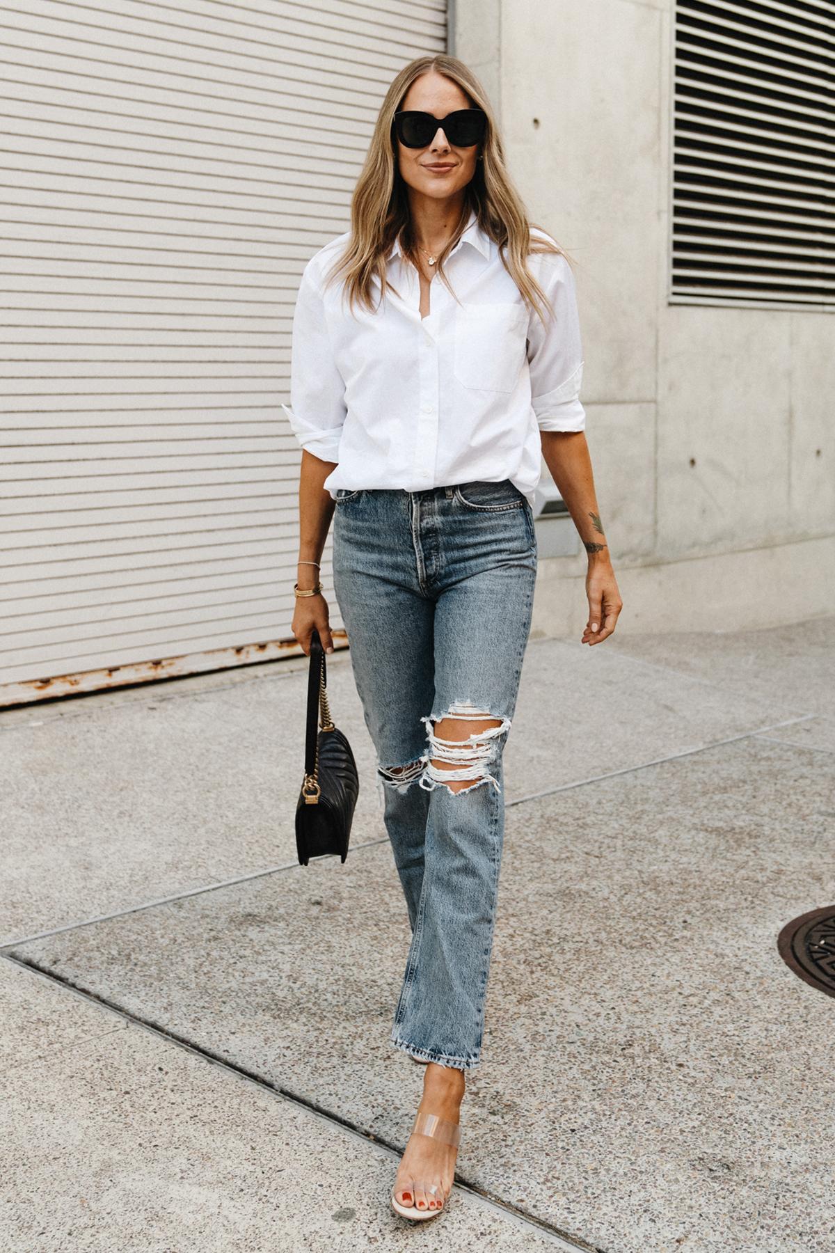Fashion Jackson Wearing Jenni Kayne White Button Up Shirt AGOLDE Ripped Jeans Schutz Clear Heeled Sandals Street Style 1