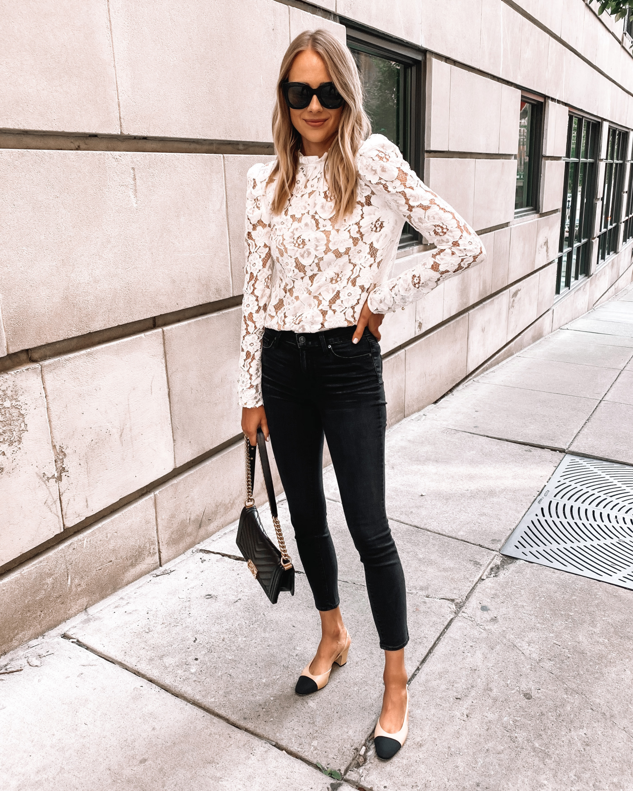 Fashion Jackson Wearing WAYF Emma White Long Sleeve Lace Top Black Skinny Jeans Chanel Slingbacks