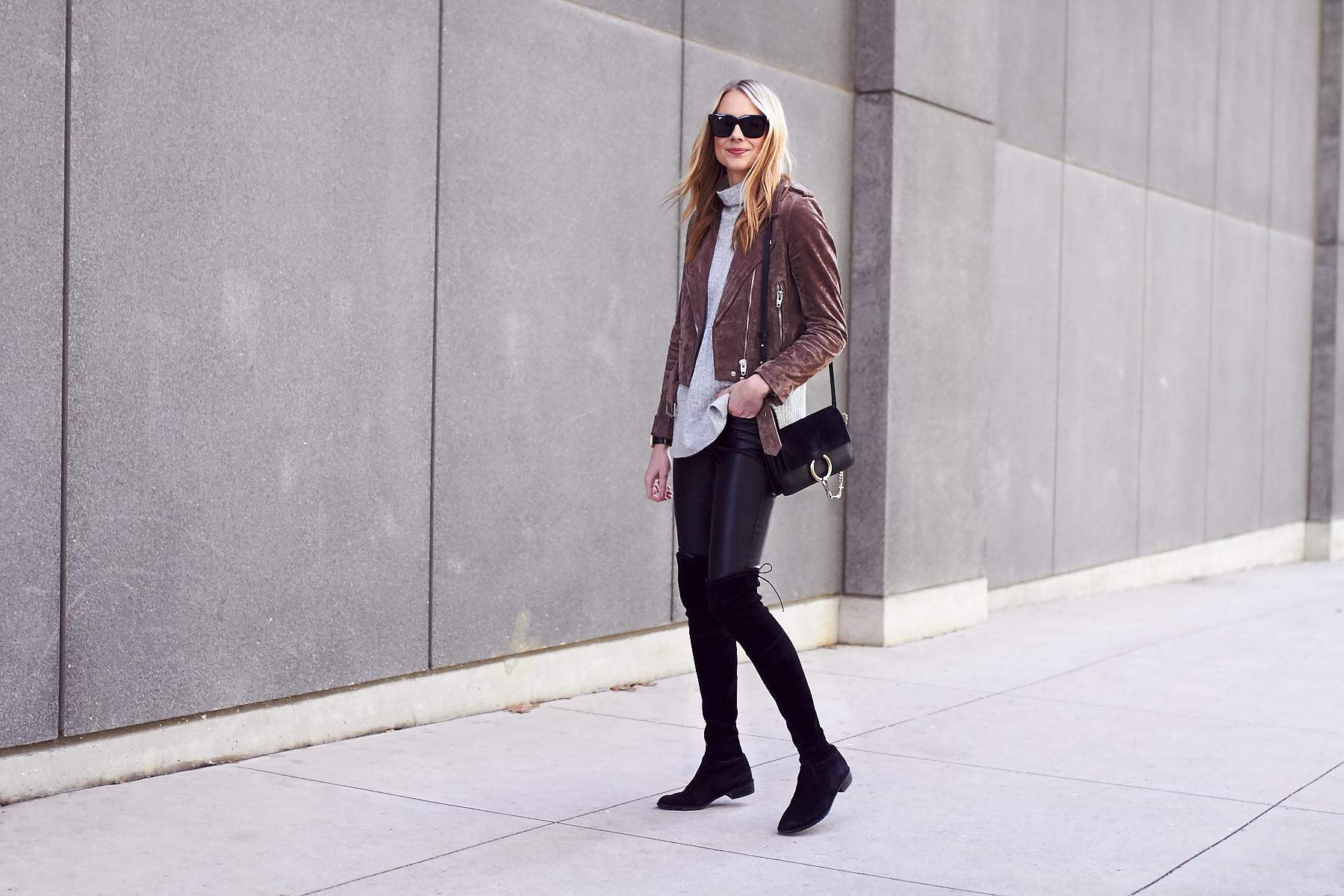 Fall Outfit, Brown Suede Moto Jacket, Grey Sweater, Stuart Weitzman Lowland Black Boots, Chloe Faye Handbag