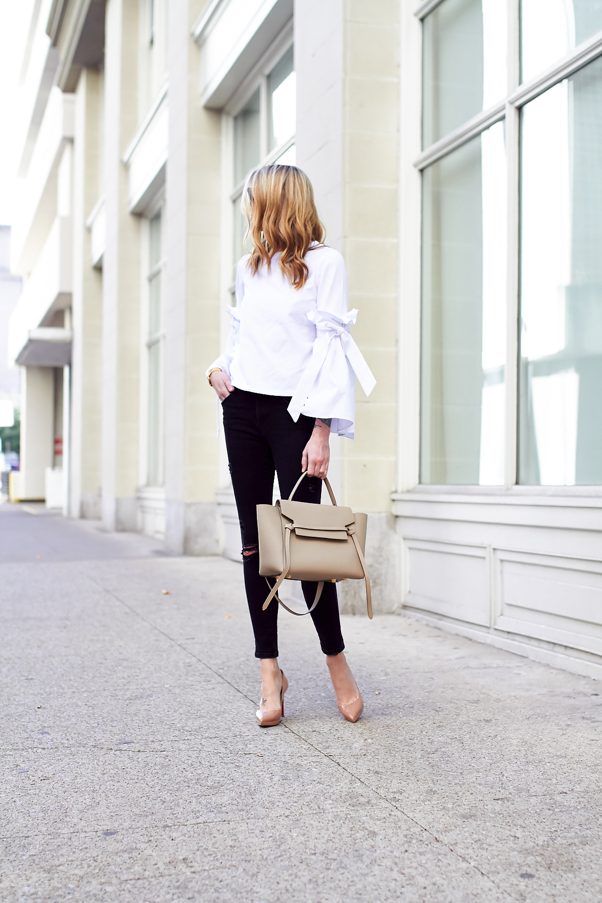 Fall Outfit, White Ruffle Sleeve Top, Black Ripped Skinny Jeans, Celine Tie Belt Bag, Christian Louboutin Nude Pumps