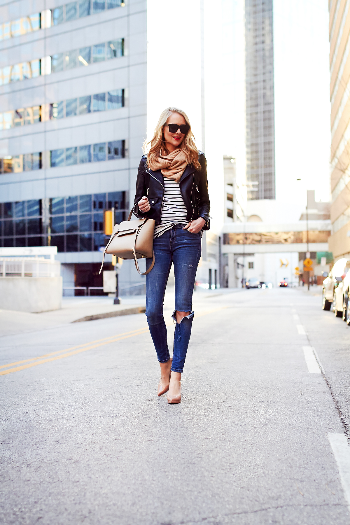 Fall Outfit, Casual Layers, Faux Leather Black Jacket, Black & White Stripe Tee, Ripped Denim Skinny Jeans, Celine Tie Belt Bag, Christian Louboutin Nude Pumps