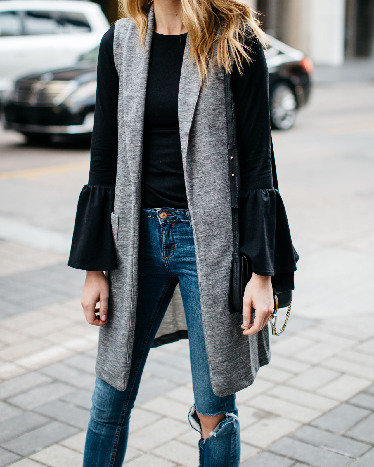 Fall Outfit, Winter Outfit, Long Grey Vest, Black Bell Sleeve Top, Chloe Faye Handbag, Denim Ripped Skinny Jeans