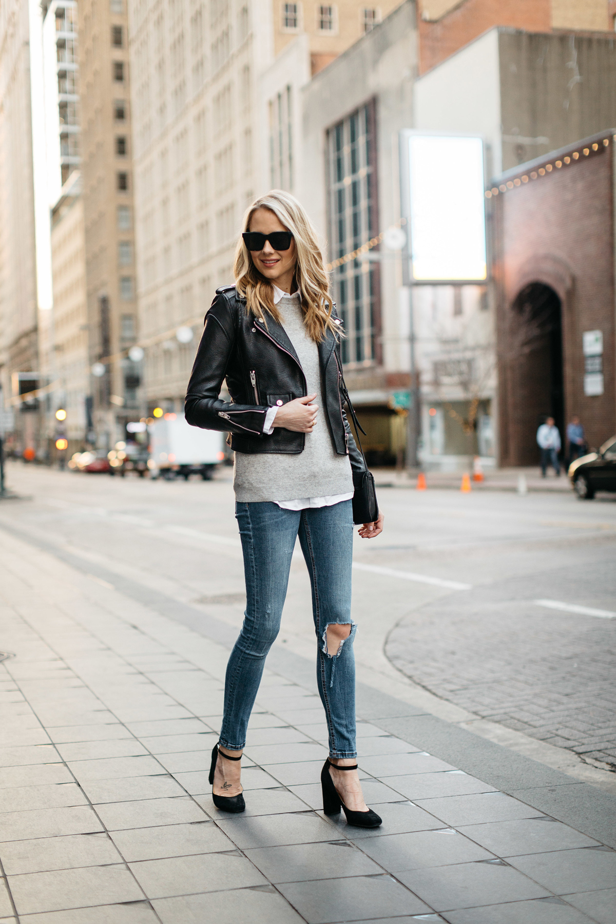 Fall Outfit, Winter Outfit, Black Leather Jacket, Grey Sweater, White Button-Down Shirt, Denim Ripped Skinny Jeans, Black Ankle Strap Pumps