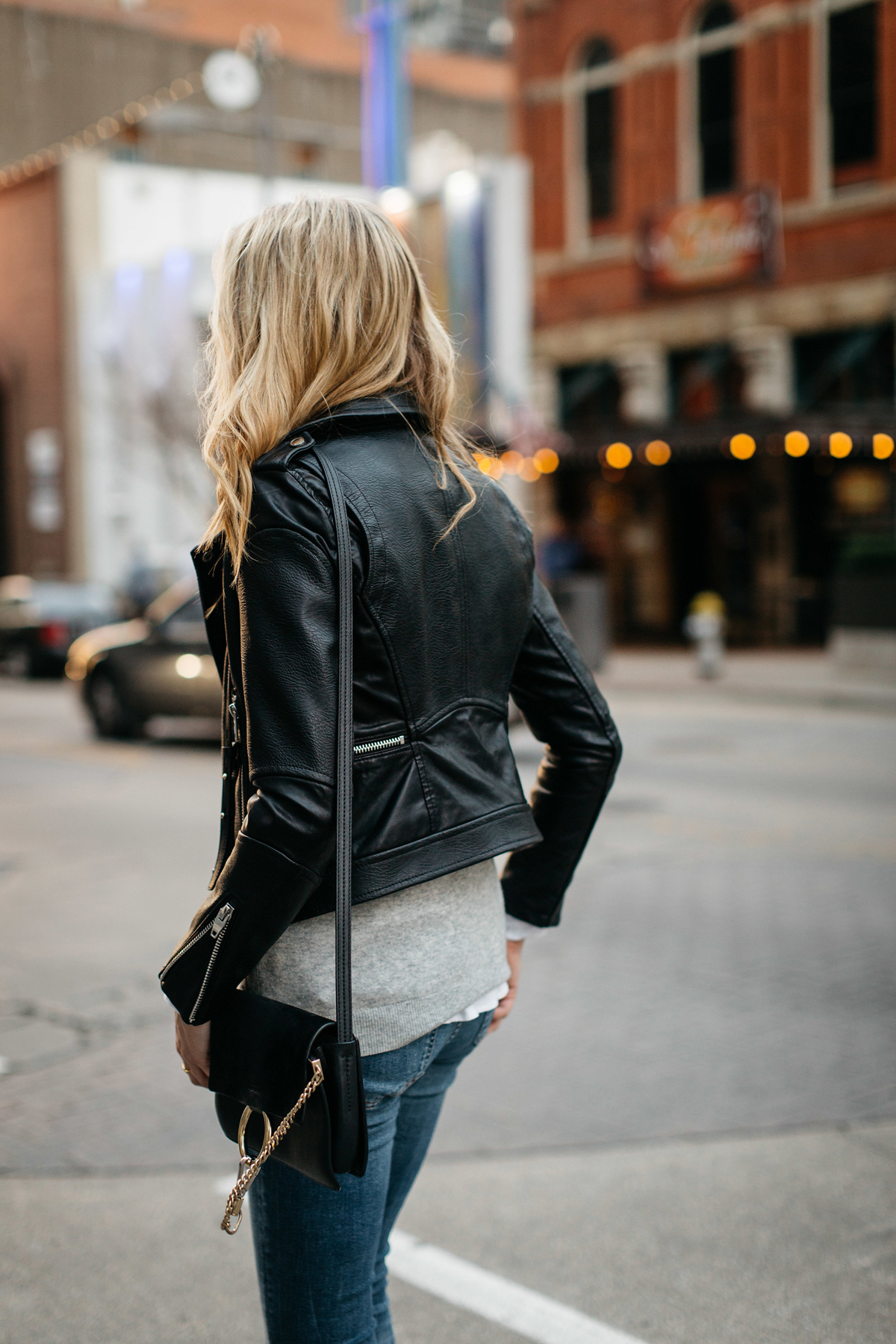 Fall Outfit, Winter Outfit, Black Leather Jacket, Grey Sweater, White Button-Down Shirt, Denim Ripped Skinny Jeans, Chloe Faye Handbag