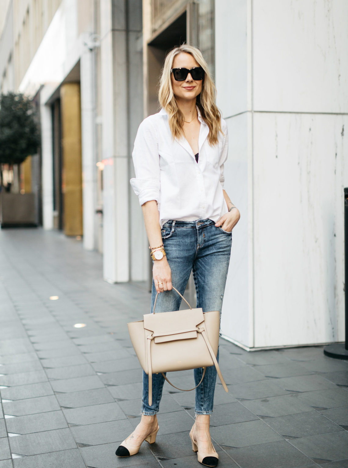 Fall Outfit, Spring Outfit, White Button-Down Shirt, Black Bralette, Denim Ripped Skinny Jeans, Celine Tie Belt Bag, Liah Slingbacks