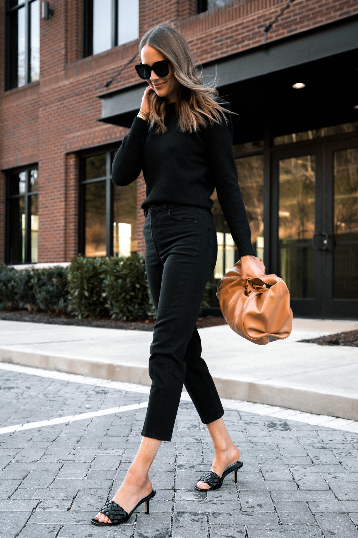 Fashion Jackson Wearing Express Black Puff Sleeve Sweater Black Mom Jeans Black Sandals Tan Handbag 1