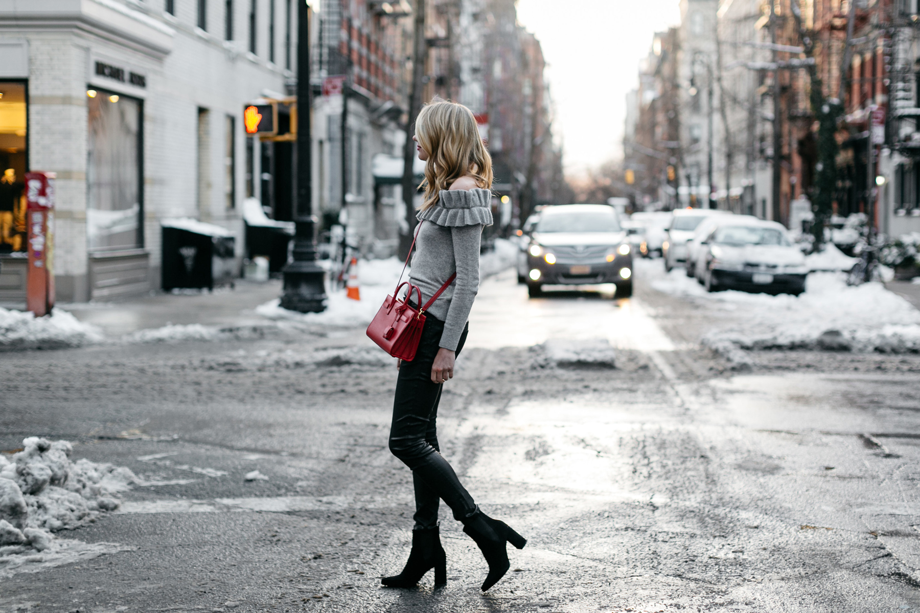NYFW Fall/Winter 2017, Streetstyle, Club Monaco Grey Ruffle Off-the-Shoulder Sweater, Black Faux Leather Pants, Saint Laurent Sac de Jour Red, Black Ankle Booties