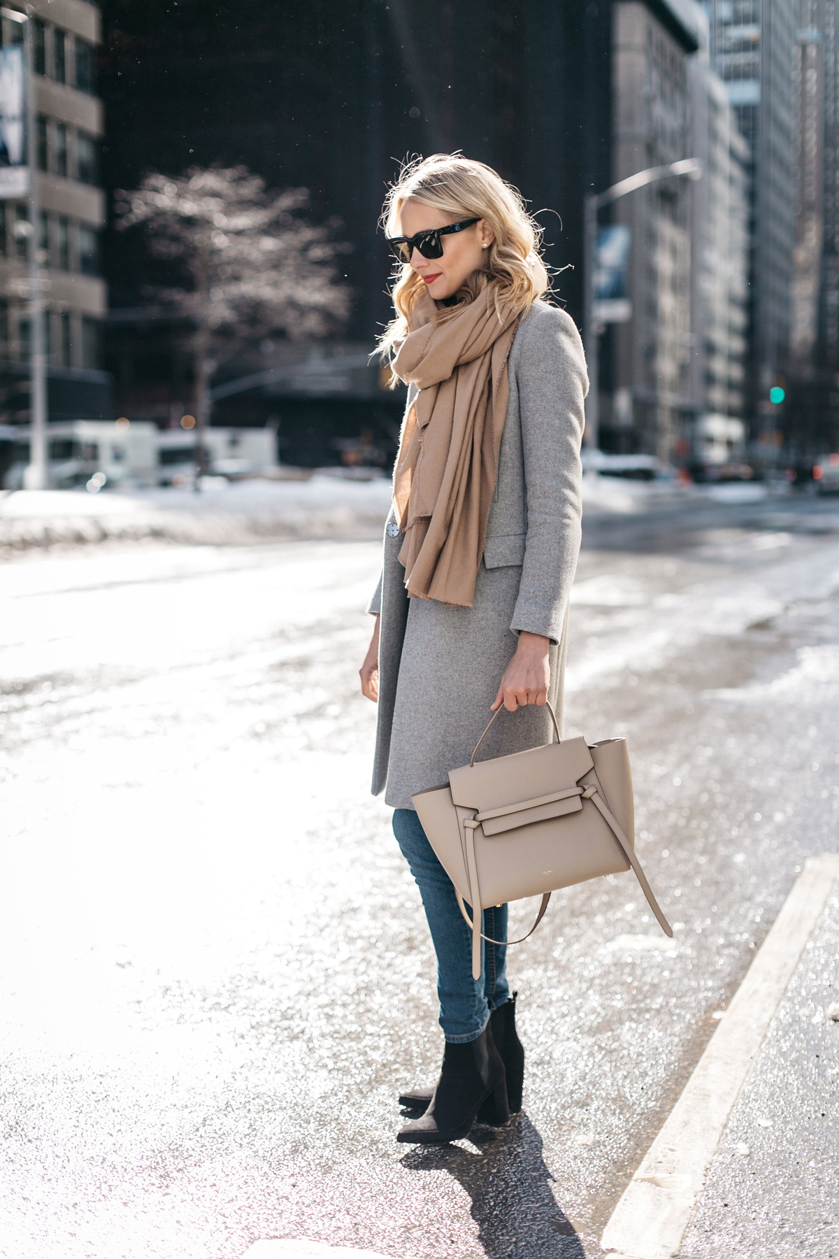 NYFW Fall/Winter 2017, Street Style, Grey Coat, Tan Blanket Scarf, Denim Skinny Jeans, Celine Tie Handbag, Black Ankle Booties
