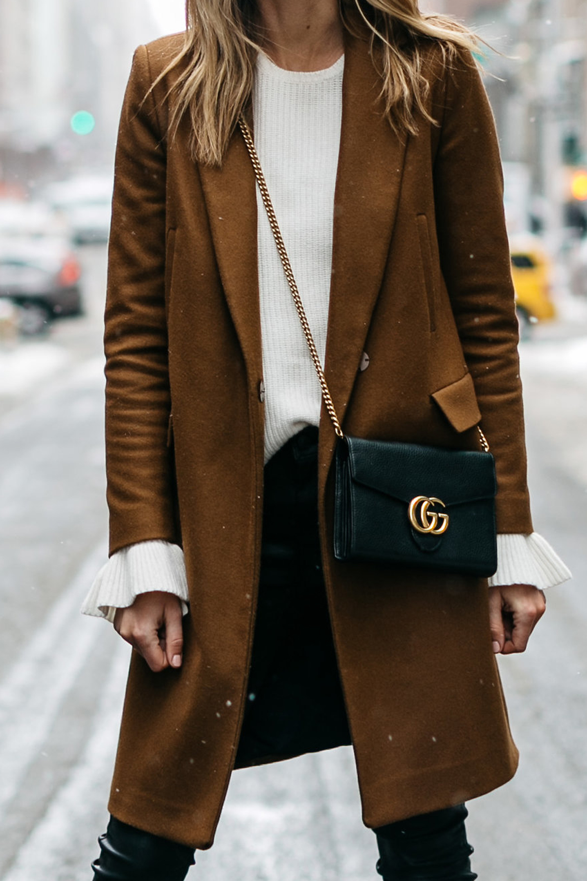 NYFW, Winter Outfit, Camel Wool Coat, White Ruffle Sleeve Sweater, Black Faux Leather Pants, Gucci Marmont Handbag, Street Style