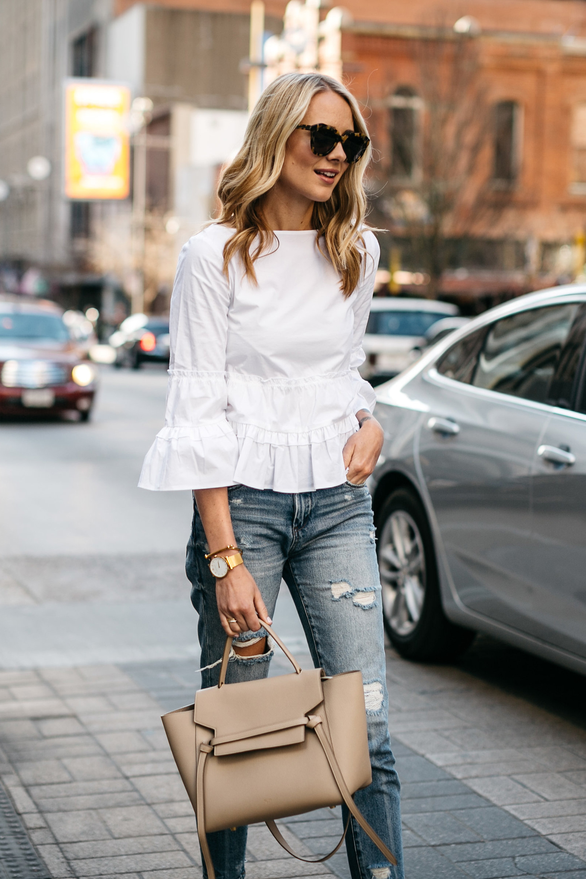 Fashion Jackson, Club Monaco White Ruffle Top, Denim Ripped Relaxed Jeans, Celine Belt Bag