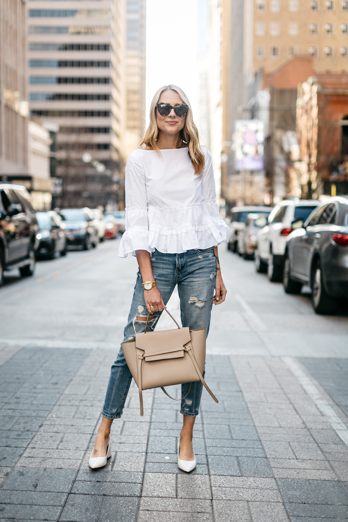 Fashion Jackson, Club Monaco White Ruffle Top, Denim Ripped Relaxed Jeans, White Block Heel Pumps, Celine Belt Bag