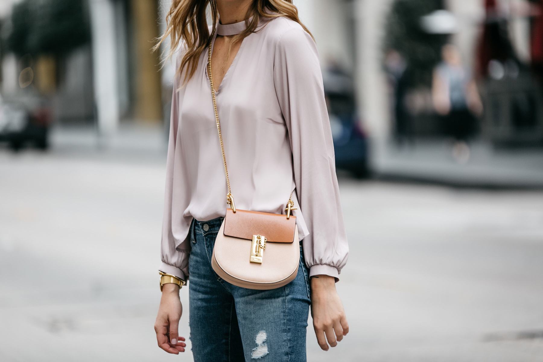 Fashion Jackson, Street Style, Blush Pink Cut Out Blouse, AG Jeans, Step Hem Distressed Skinny Ankle Jeans, Chloe Drew Handbag