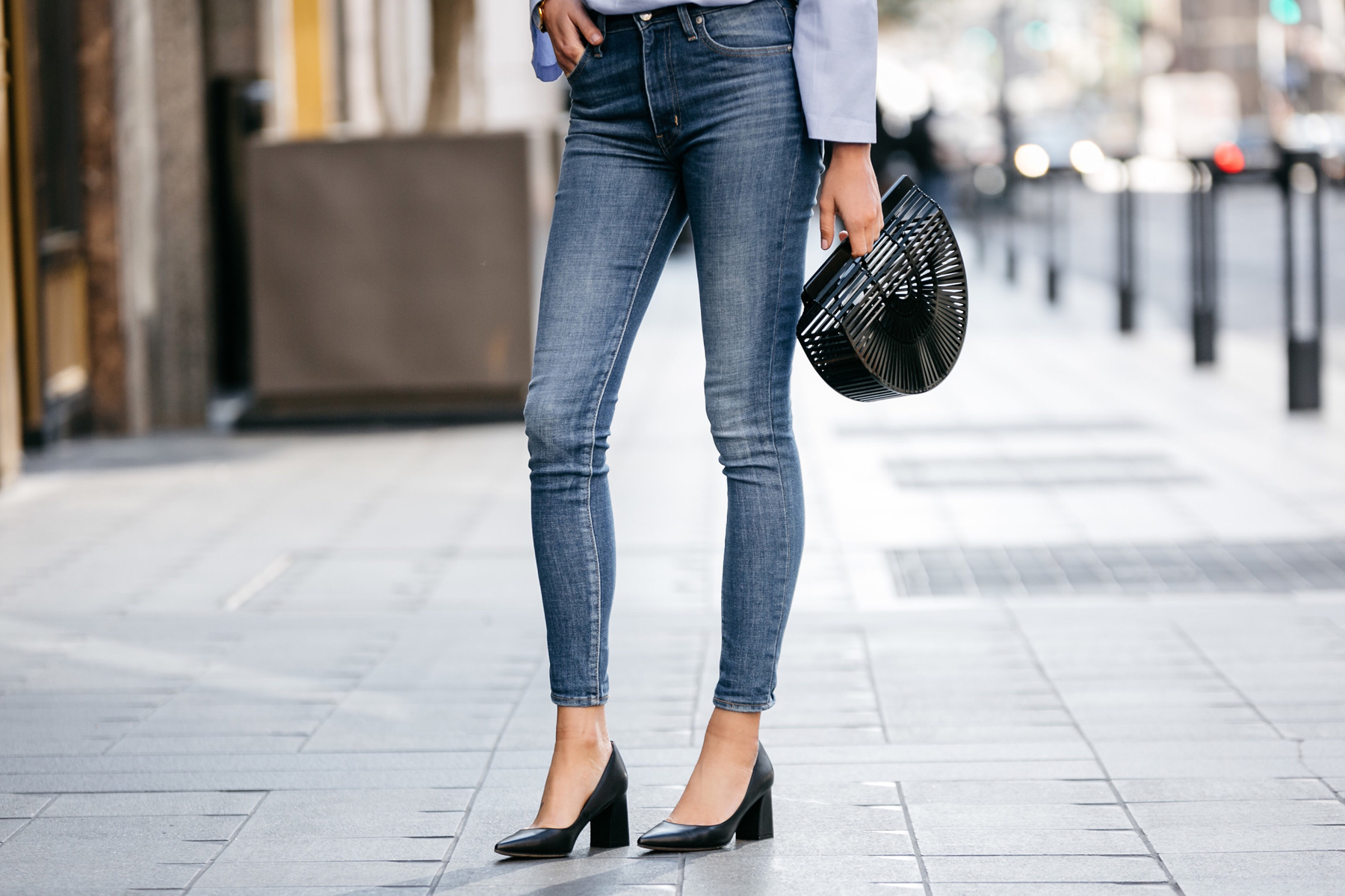 Fashion Jackson, Street Style, Blue Bell Sleeve Top, Levi's Mile High Skinny Jeans, Cult Gaia Black Acrylic Ark Clutch, Marc Fisher Zala Black Pumps