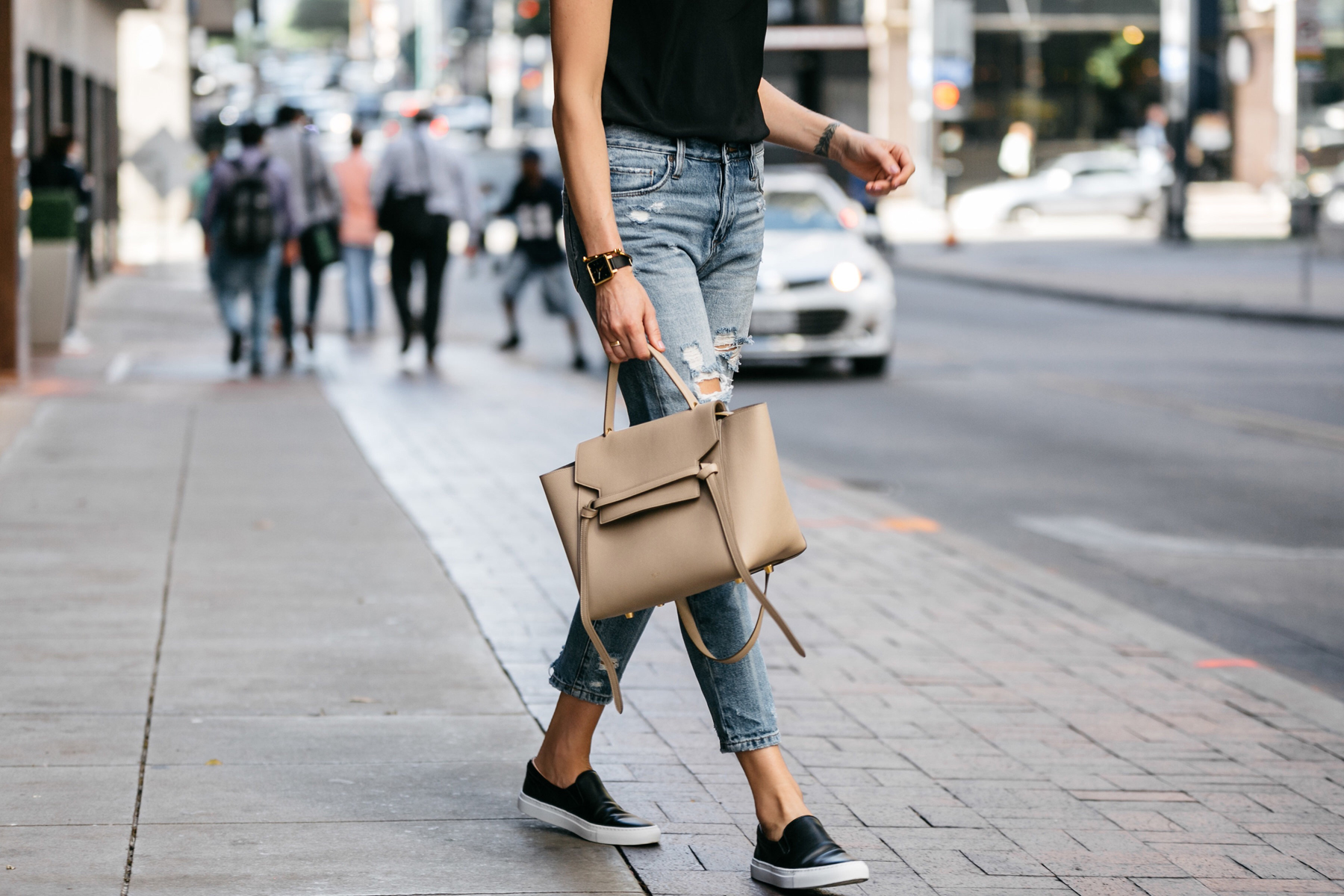 Fashion Jackson, Dallas Blogger, Fashion Blogger, Street Style, Club Monaco Black Cami, Blanknyc Ms Throwback Denim Ripped Relaxed Jeans, Celine Belt Bag, Greats The Wooster Sneaker, Black Slip-On Sneakers