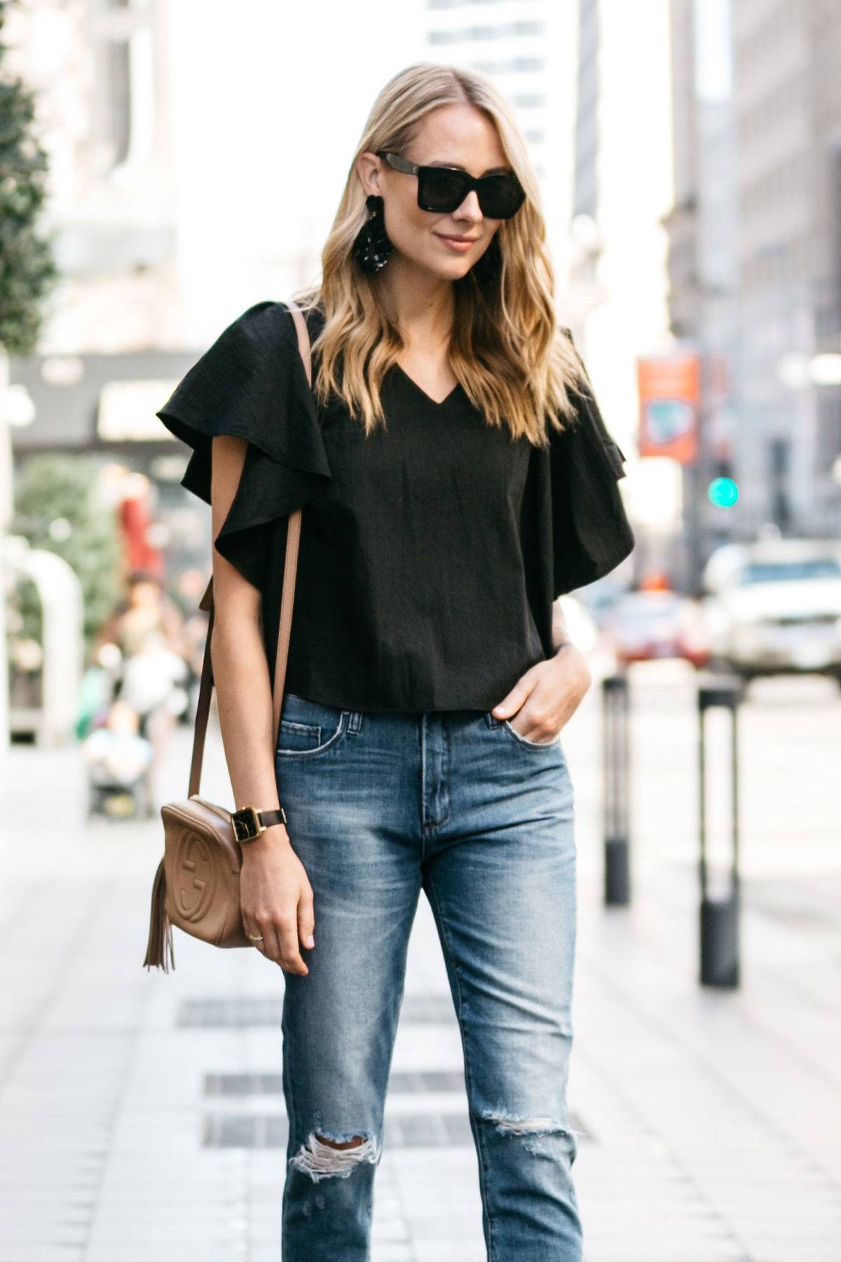 Black Ruffle Sleeve Top, Ripped Skinny Crop Jeans, Gucci Soho Disco Handbag