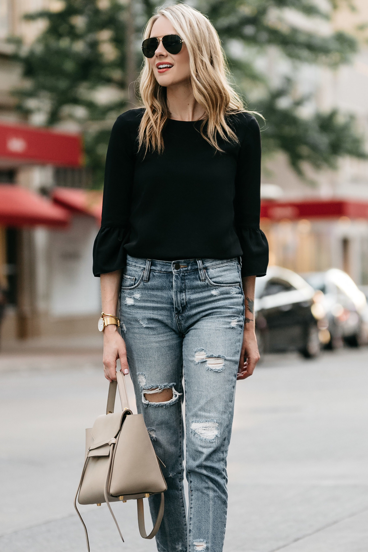 Fashion Jackson, Dallas Blogger, Fashion Blogger, Street Style, Black Bell Sleeve Top, Denim Ripped Mom Jeans, Celine Belt Bag, Celine Aviator Sunglasses