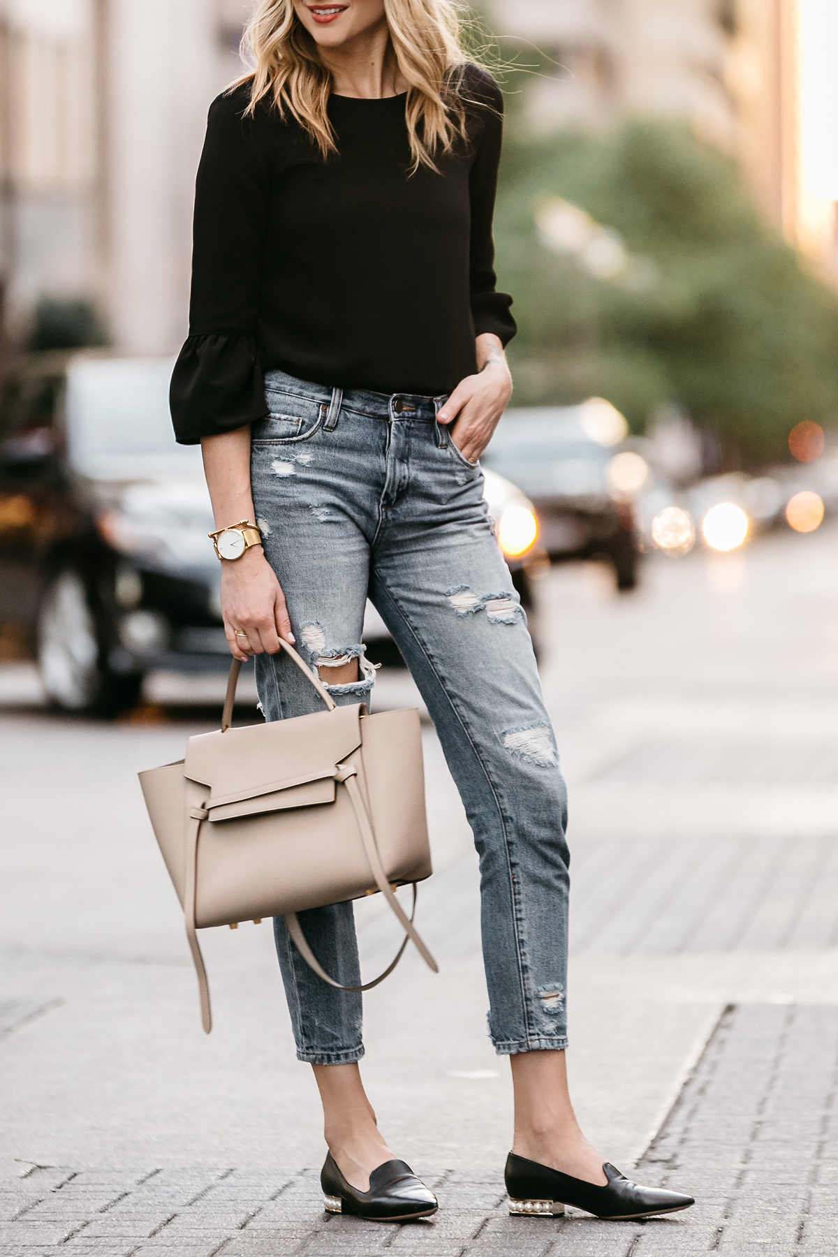 Fashion Jackson, Dallas Blogger, Fashion Blogger, Street Style, Black Bell Sleeve Top, Denim Ripped Mom Jeans, Celine Belt Bag, Nicholas Kirkwood Pearl Heeled Loafers