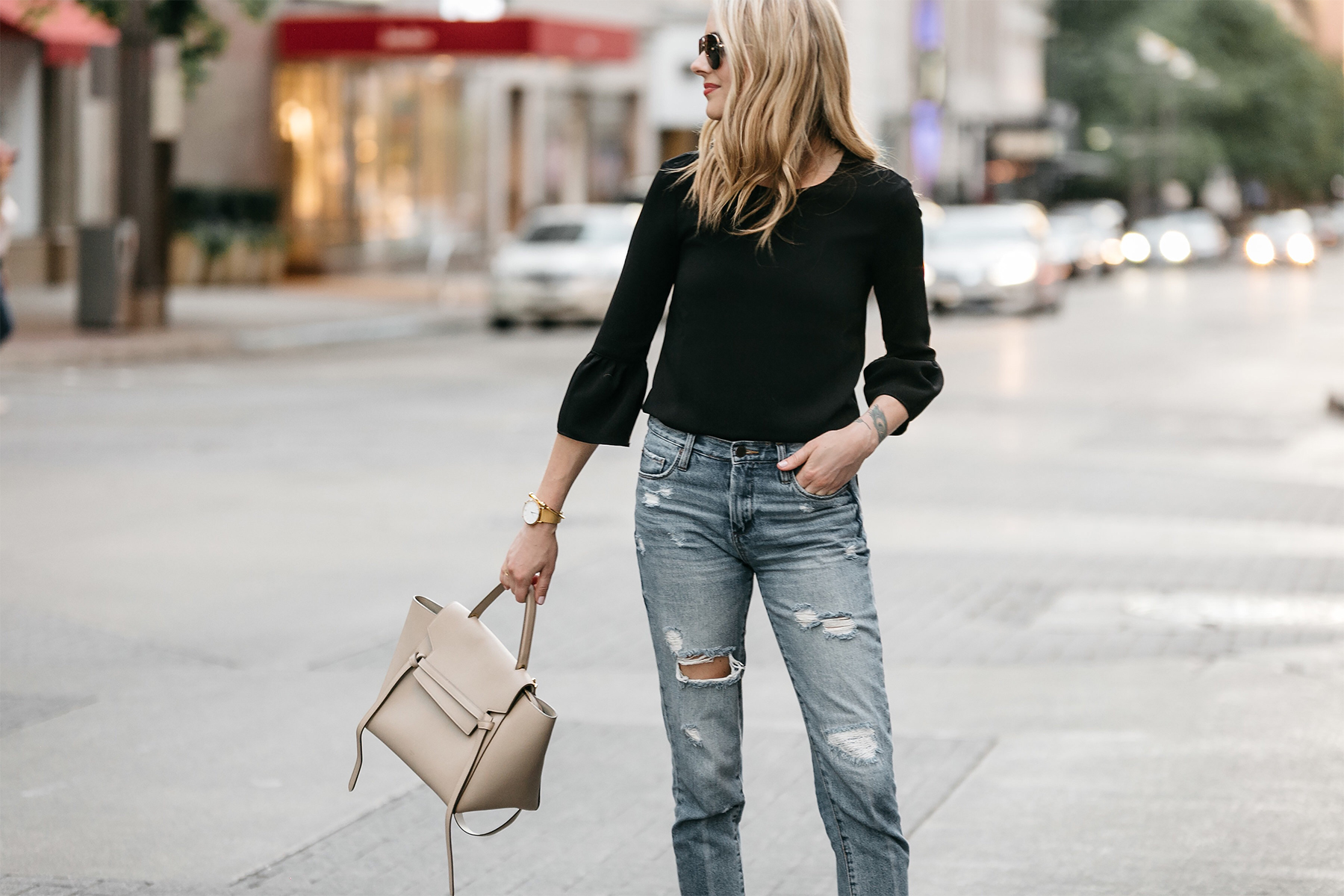 Fashion Jackson, Dallas Blogger, Fashion Blogger, Street Style, Black Bell Sleeve Top, Denim Ripped Mom Jeans, Celine Belt Bag