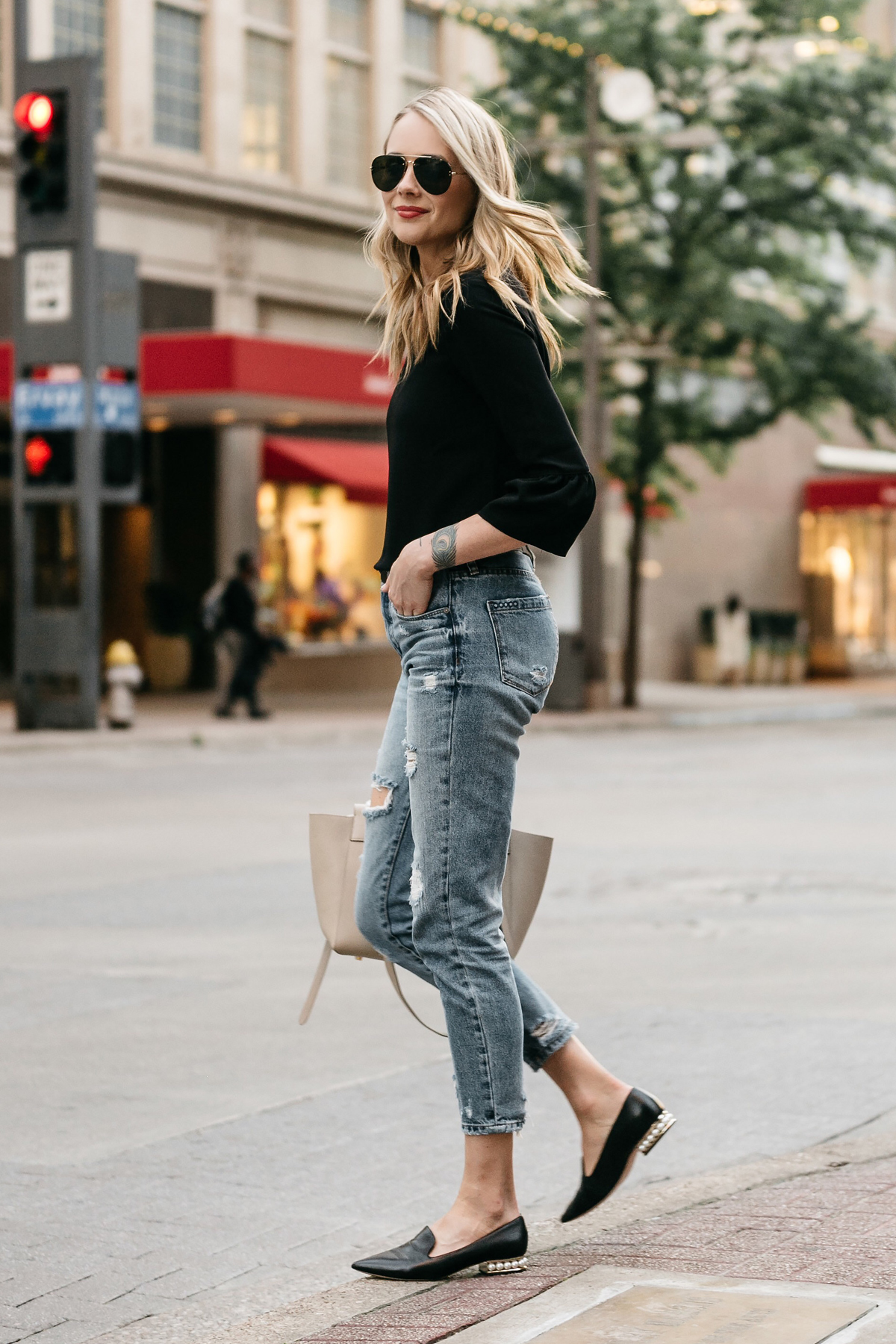 Fashion Jackson, Dallas Blogger, Fashion Blogger, Street Style, Black Bell Sleeve Top, Denim Ripped Mom Jeans, Celine Belt Bag, Celine Aviator Sunglasses, Nicholas Kirkwood Pearl Heeled Loafers