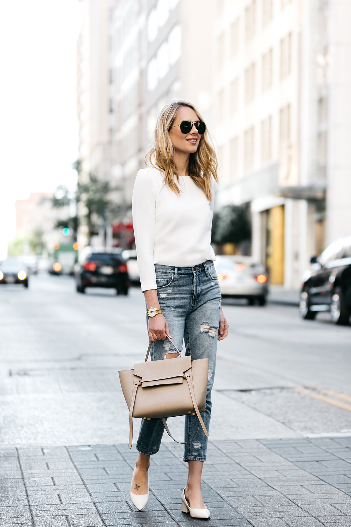 Fashion Jackson, Dallas, Blogger, Fashion Blogger, Street Style, Ann Taylor White Puff Sleeve Top, Celine Belt Bag, Blanknyc Denim Ripped Mom Jeans, Zara White Block Heels