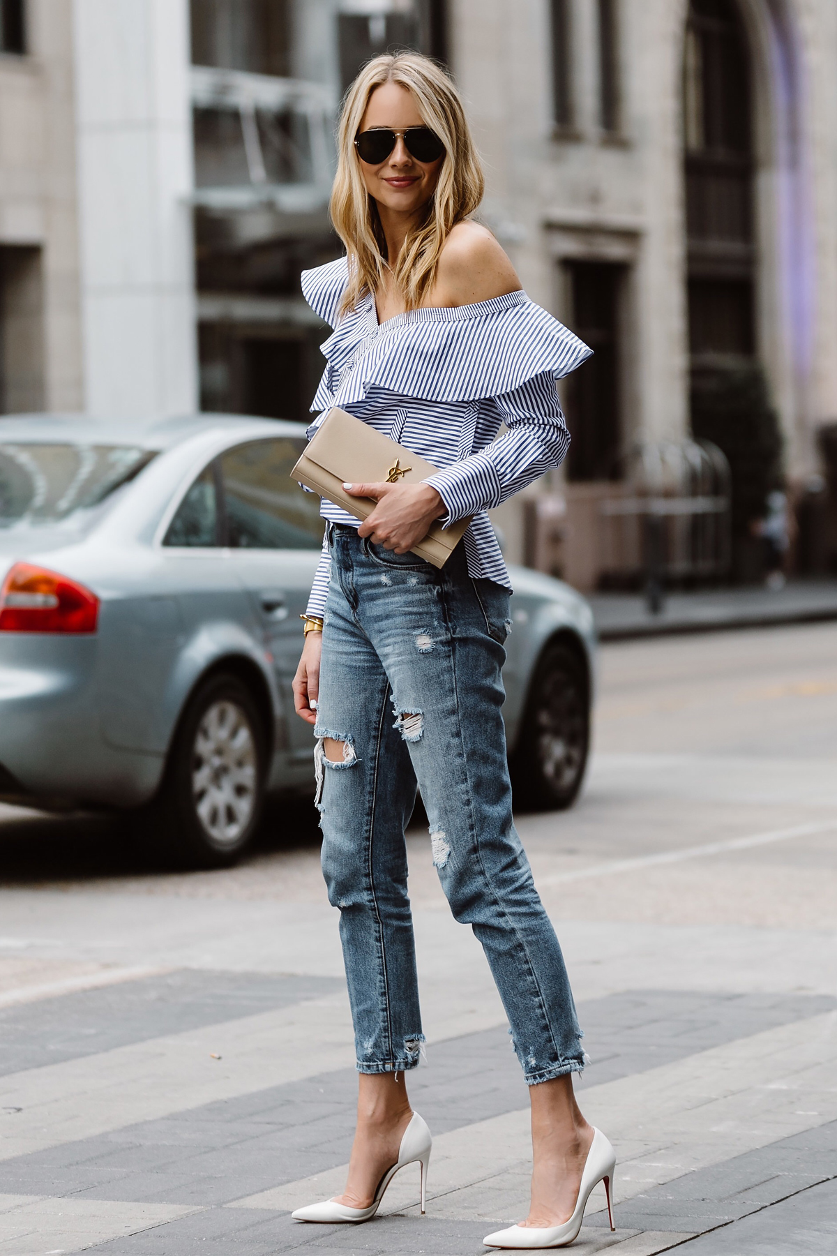 Fashion Jackson, Dallas Blogger, Fashion Blogger, Street Style, Self-Portrait Asymmetrical Ruffle Top, Blue White Stripe Top, Blanknyc Ms Throwback Relaxed Denim Ripped Jeans, Saint Laurent Monogram Clutch, Celine Aviator Sunglasses, Christian Louboutin White Pumps