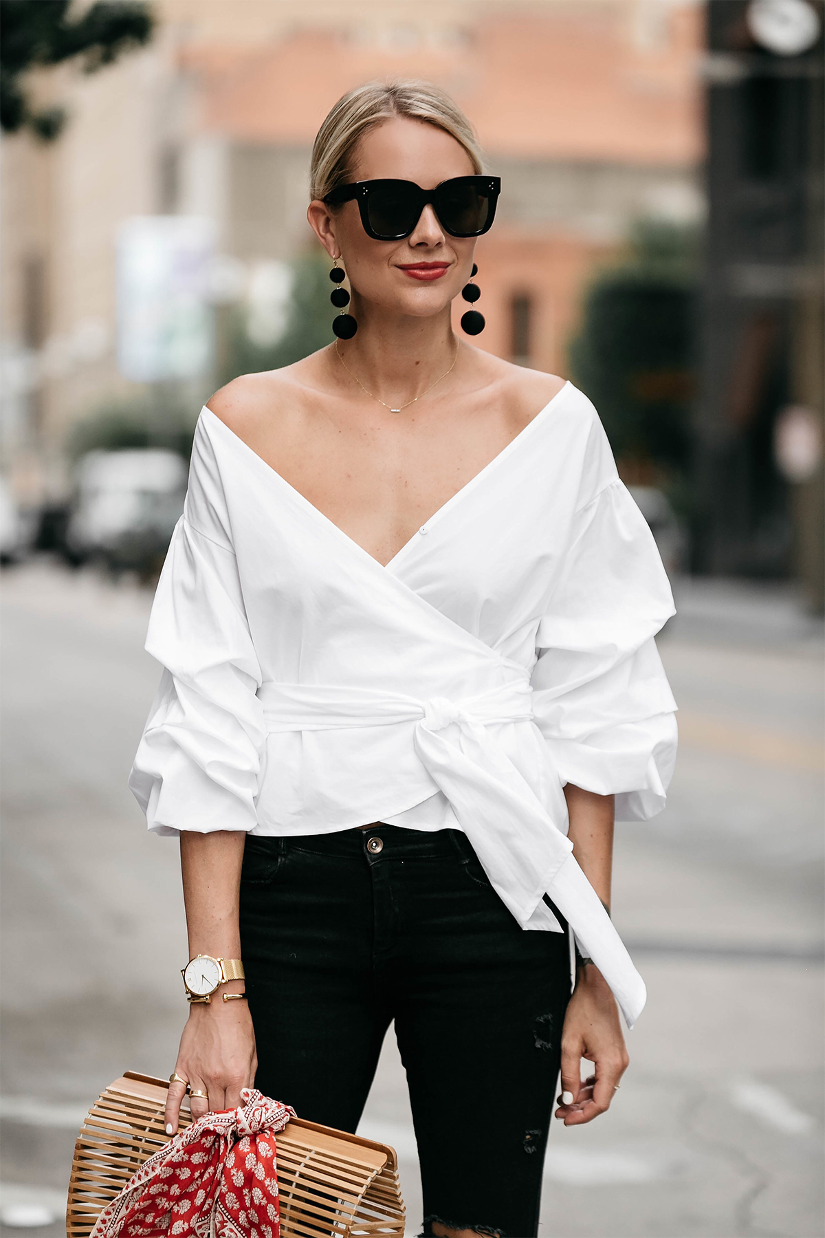 Blonde Woman Wearing Club Monaco Ruffle Sleeve Wrap Top Bauble Bar Crispin Earrings Street Style Outfit