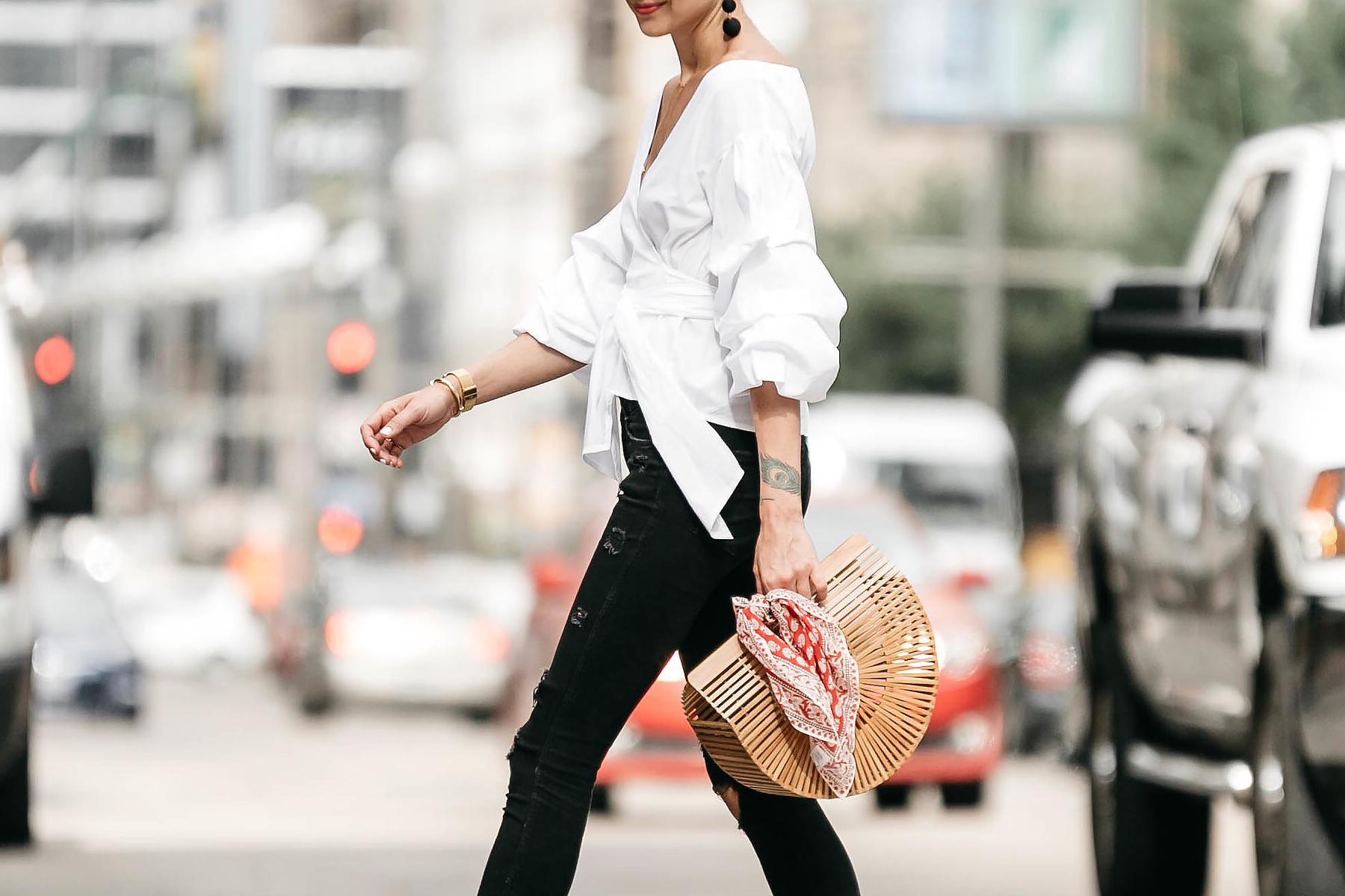 Woman Wearing Club Monaco Ruffle Sleeve Wrap Top Cult Gaia Ark Bag Red Bandana Black Ripped Skinny Jeans Street Style Outfit