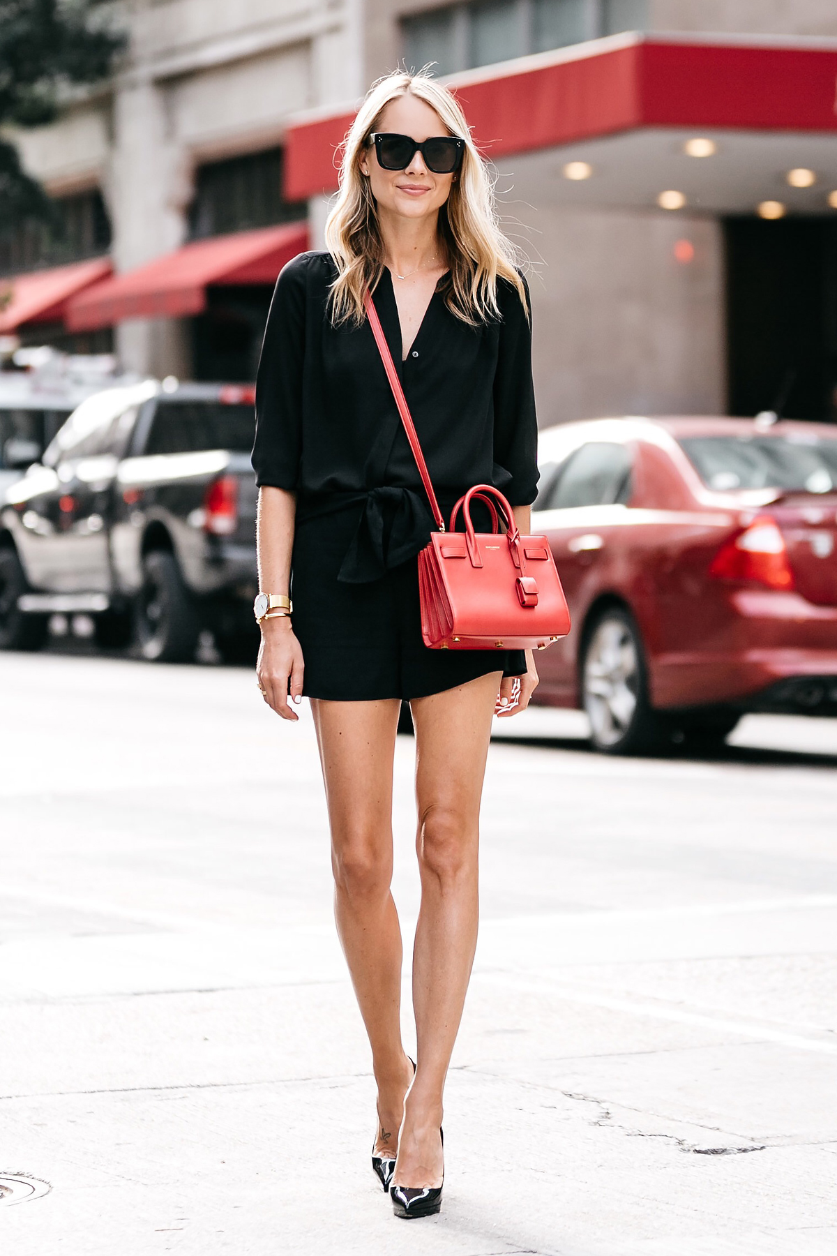 Blonde Woman Wearing Nordstrom Black Blouse Nordstrom Black Tie Front Shorts YSL Sac De Jour Nano Red Christian Louboutin Black Pumps Street Style Outfit Dallas Blogger Fashion Blogger