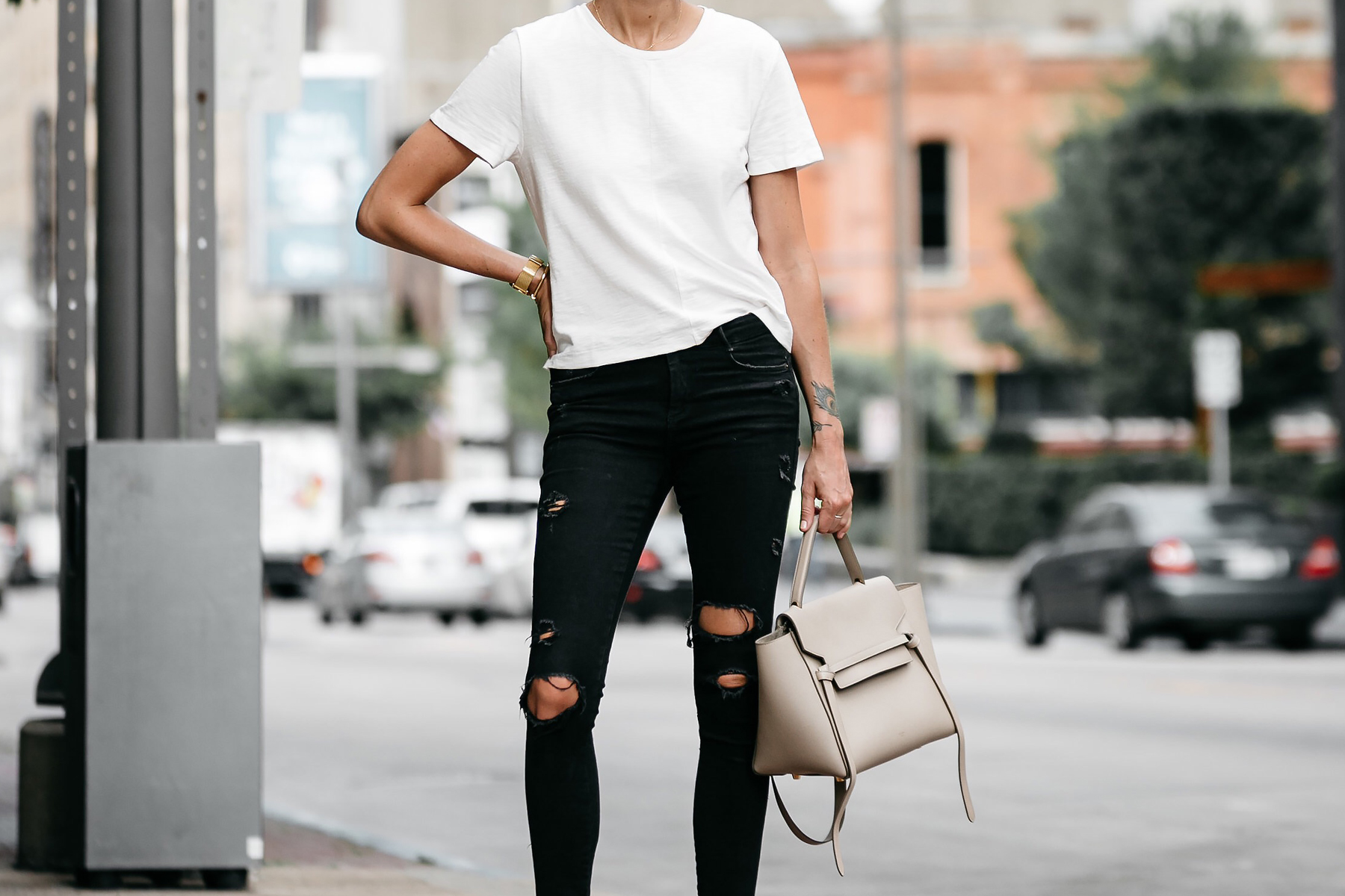 woman wearing everlane white tshirt zara black ripped skinny jeans outfit celine belt back street style dallas blogger fashion blogger