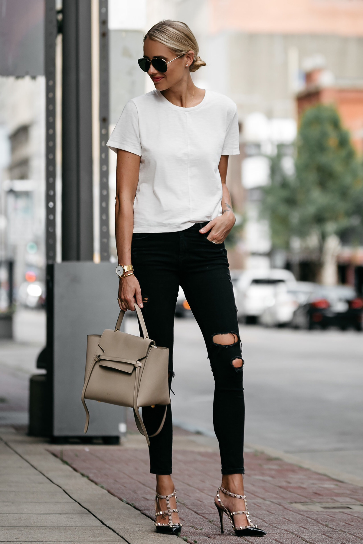 Blonde woman wearing everlane white tshirt zara black ripped skinny jeans outfit valentinio rockstud pumps celine belt back street style dallas blogger fashion blogger