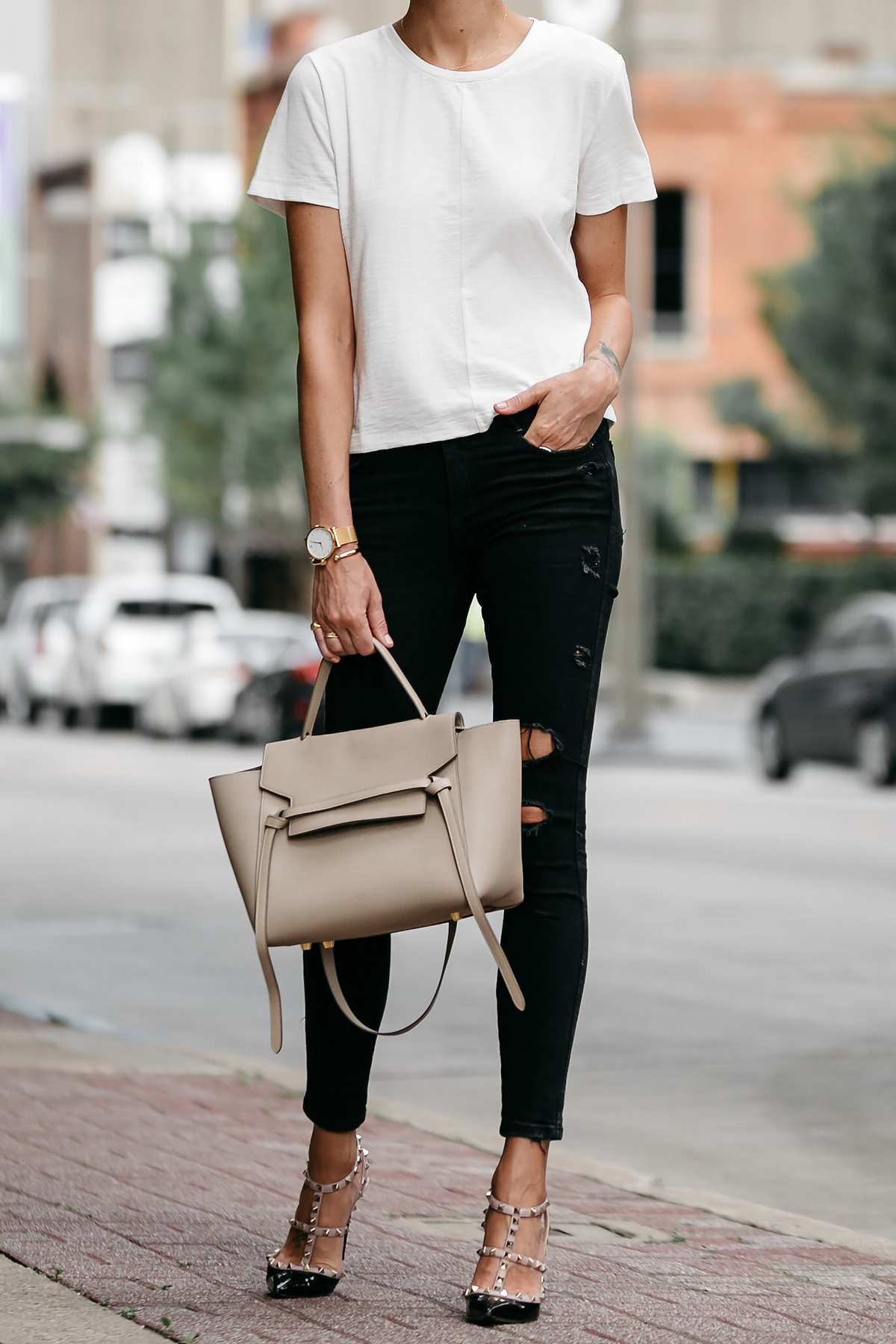 woman wearing everlane white tshirt zara black ripped skinny jeans outfit valentinio rockstud pumps celine belt back street style dallas blogger fashion blogger
