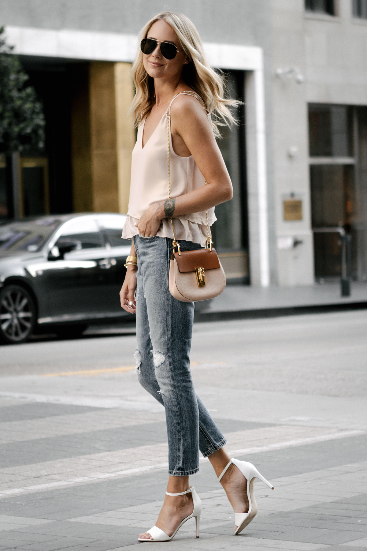 Blonde Woman Wearing Mango Blush Pink Camisole Levis Distressed Jeans Aldo White Heeled Sandals Chloe Drew Handbag
