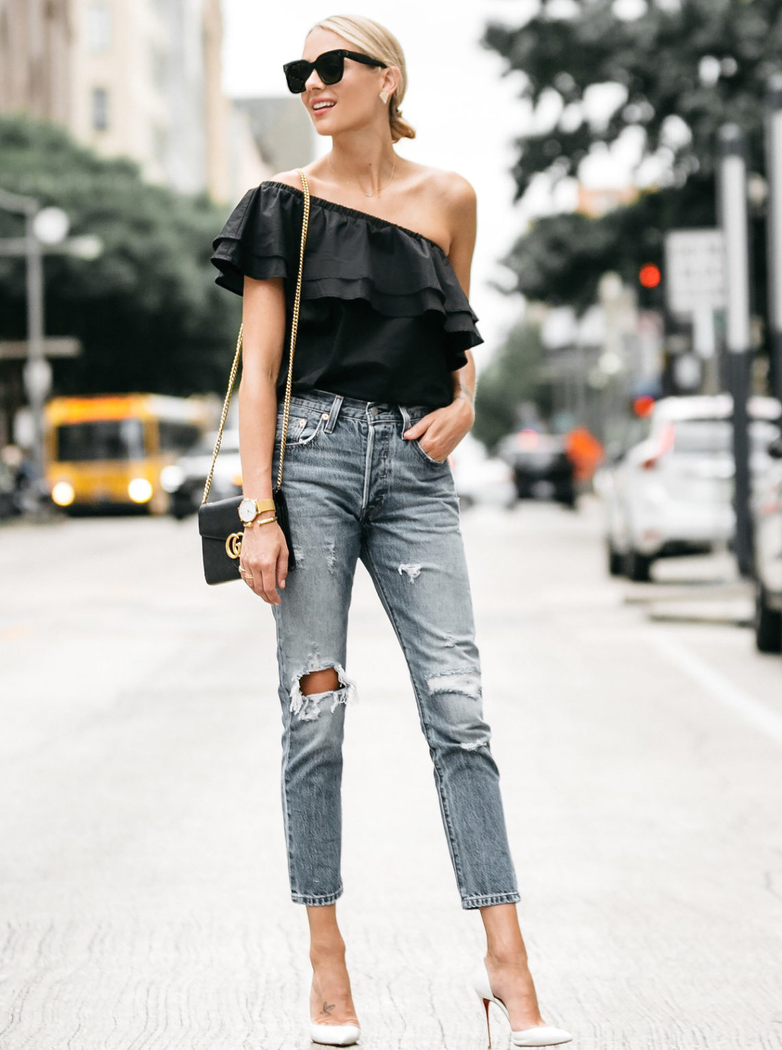 40e969fa6bc Blonde woman wearing nordstrom black one shoulder ruffle top levis distressed  jeans christian louboutin white pumps