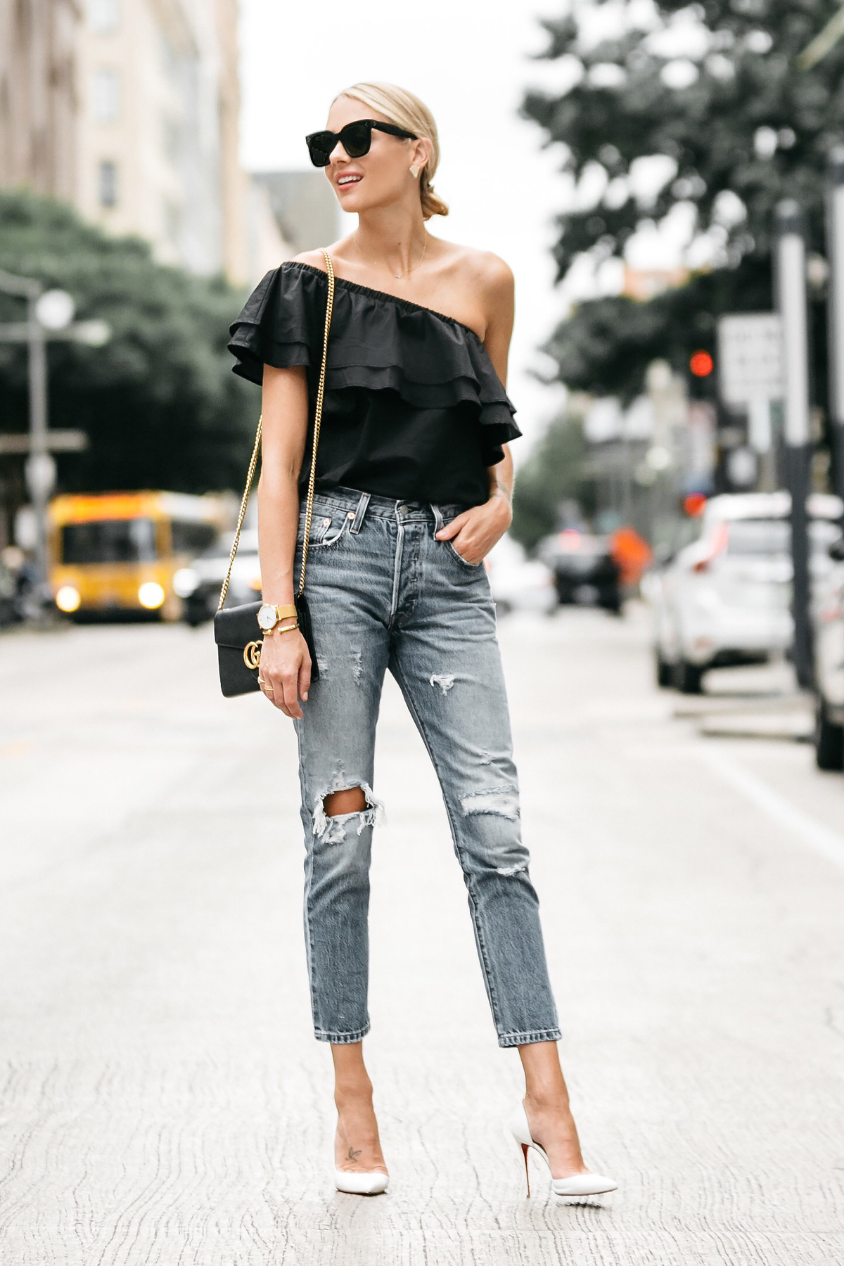 980b732498b Blonde woman wearing nordstrom black one shoulder ruffle top levis  distressed jeans christian louboutin white pumps