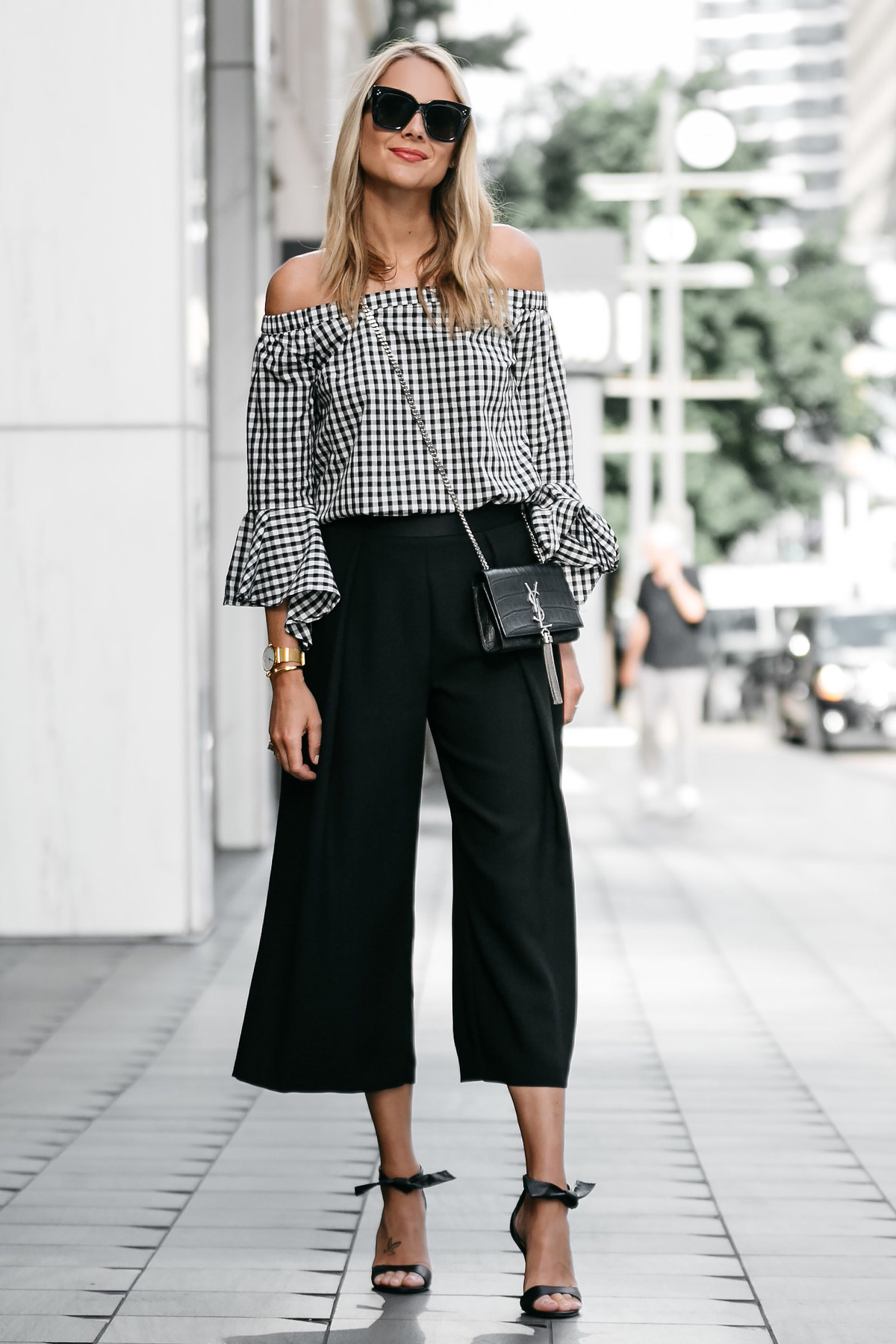 Blonde woman wearing nordstrom gingham off-the-shoulder top topshop black culottes outfit black bow heels ysl crossbody street style dallas blogger fashion blogger