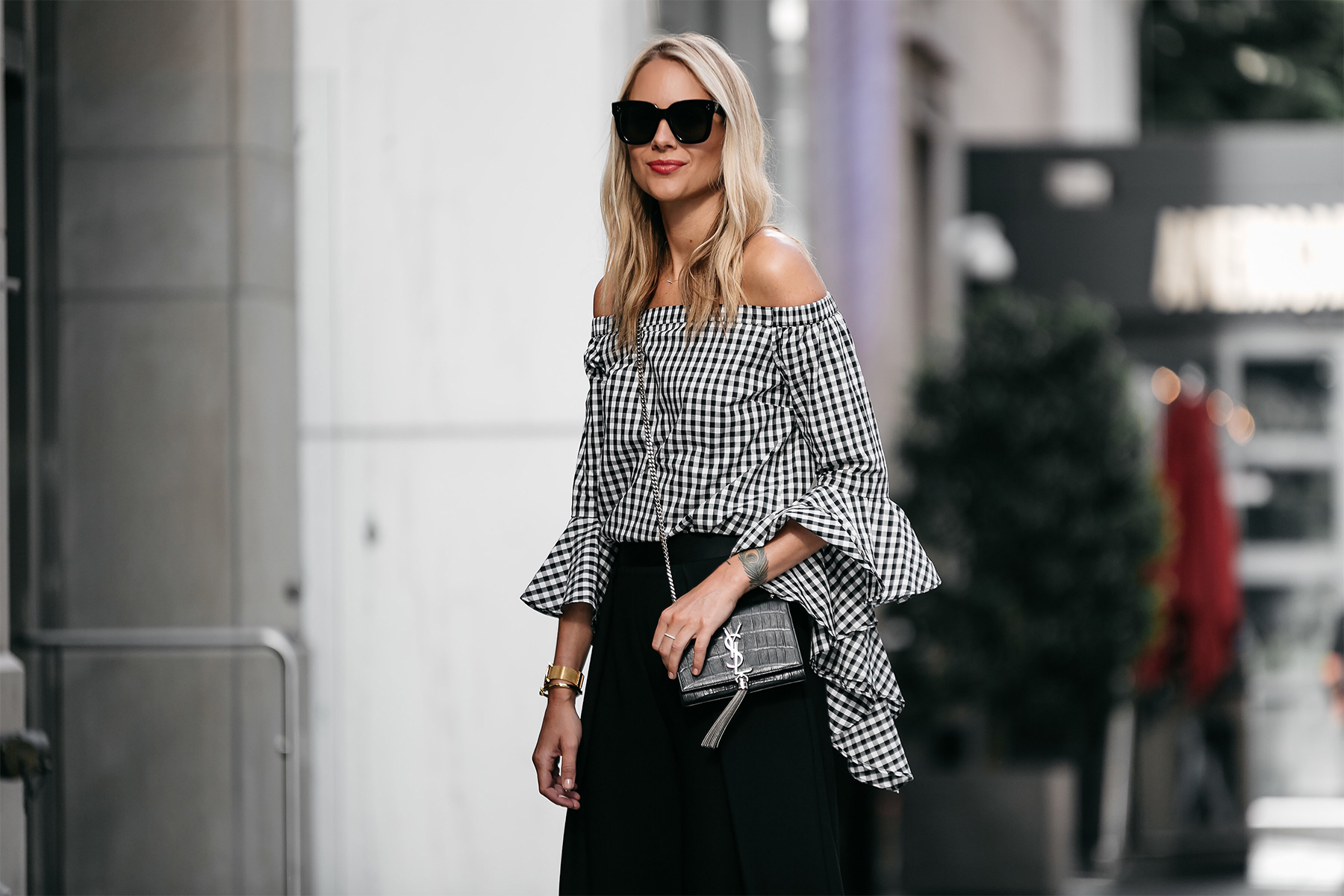 Blonde woman wearing gingham off-the-shoulder top with YSL Crossbody Street Style Dallas Blogger Fashion Blogger
