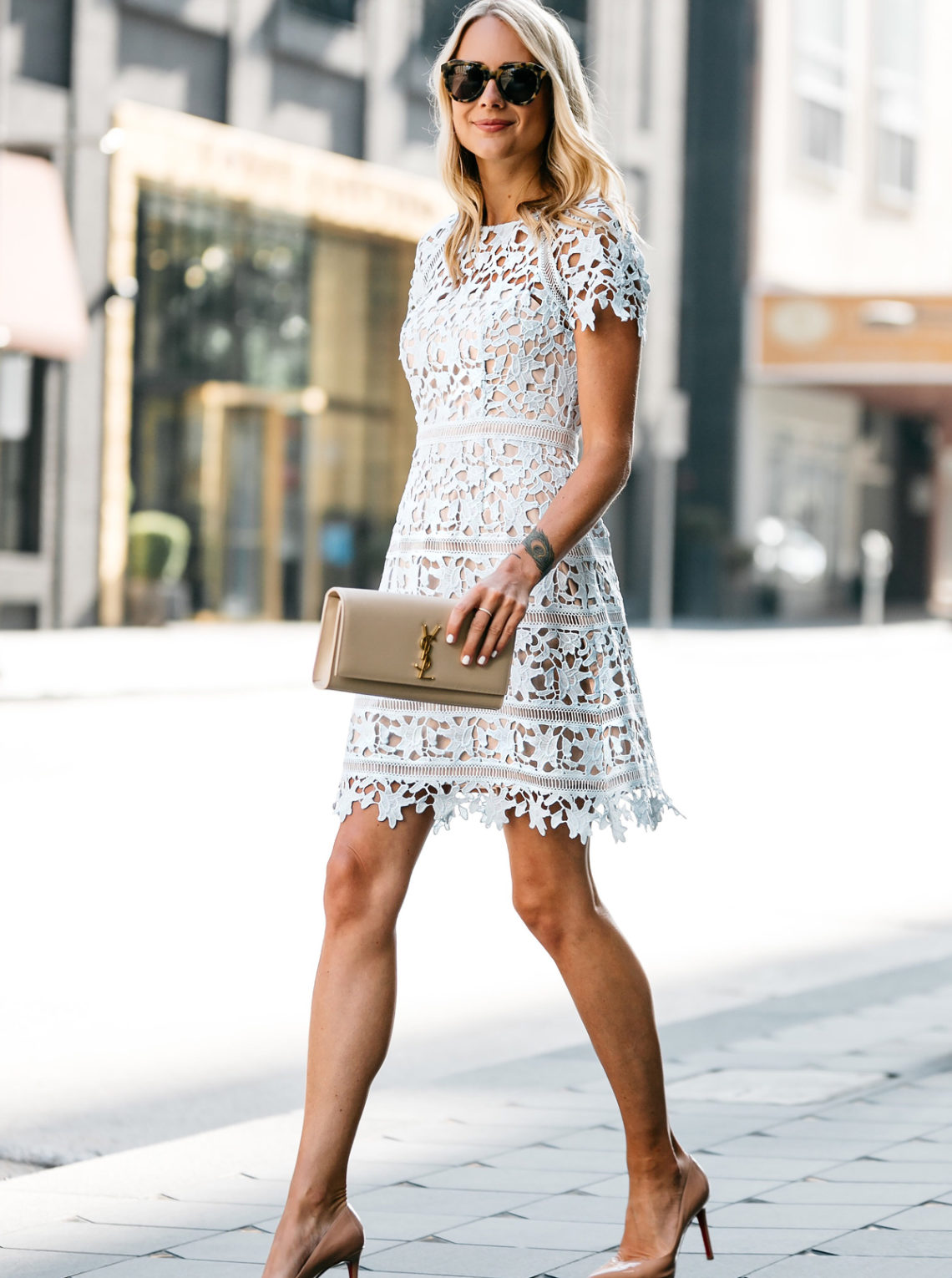 Blonde Woman Wearing Nordstrom Short Sleeve Blue Lace Dress Holding YSL Nude Clutch