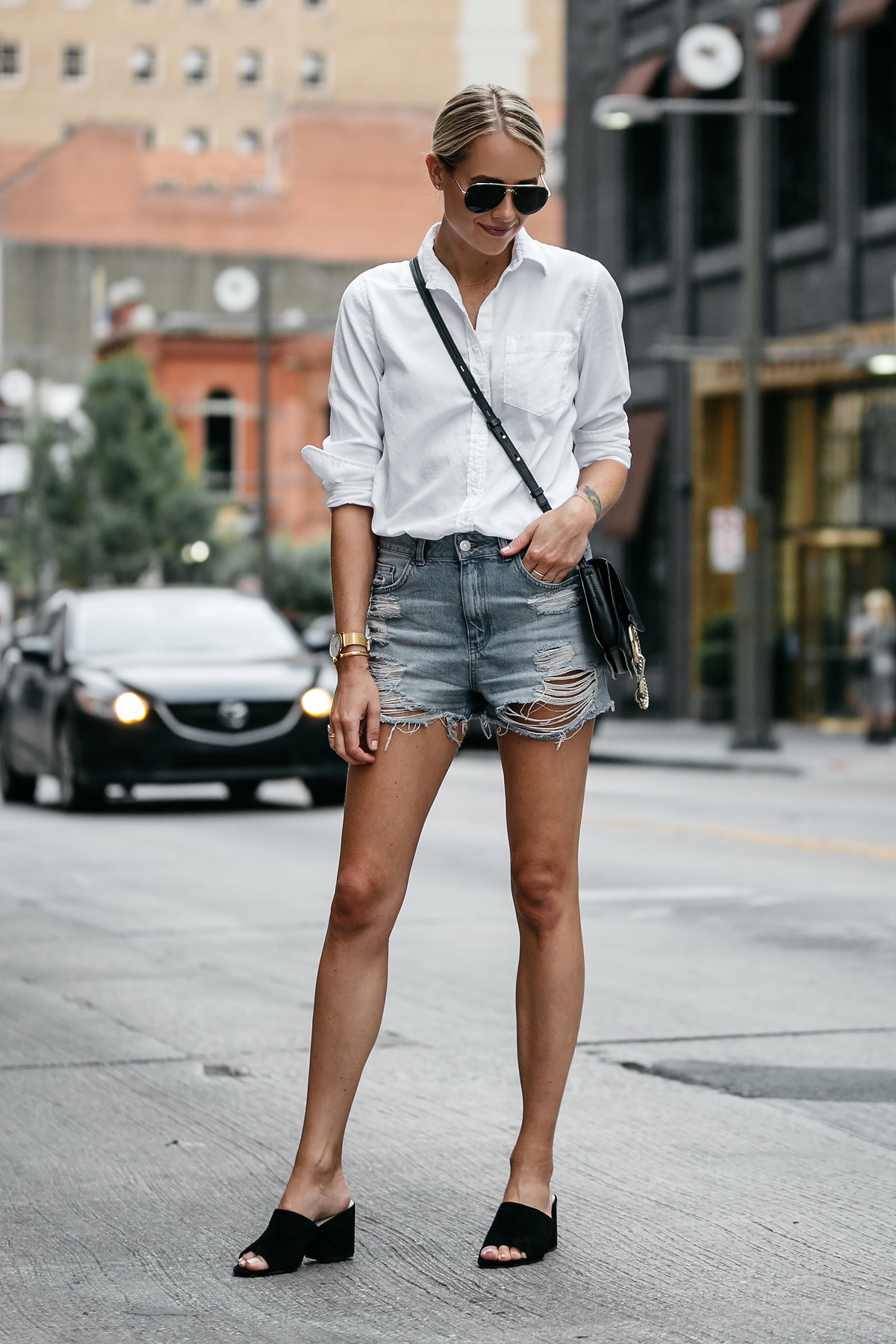 Blonde Woman Wearing Banana Republic White Button Down Shirt Topshop Ripped Denim Cutoff Shorts Outfit Steve Madden Black Mules Chloe Faye Handbag Street Style Dallas Blogger Fashion Blogger Fashion Jackson