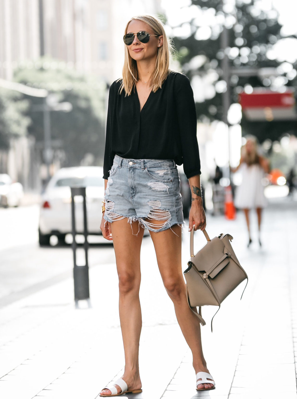 ec70c9dfd89 Blonde Woman Wearing Nodstrom Black Long Sleeve Button Down Blouse Topshop  Denim Ripped Mom Shorts Outfit
