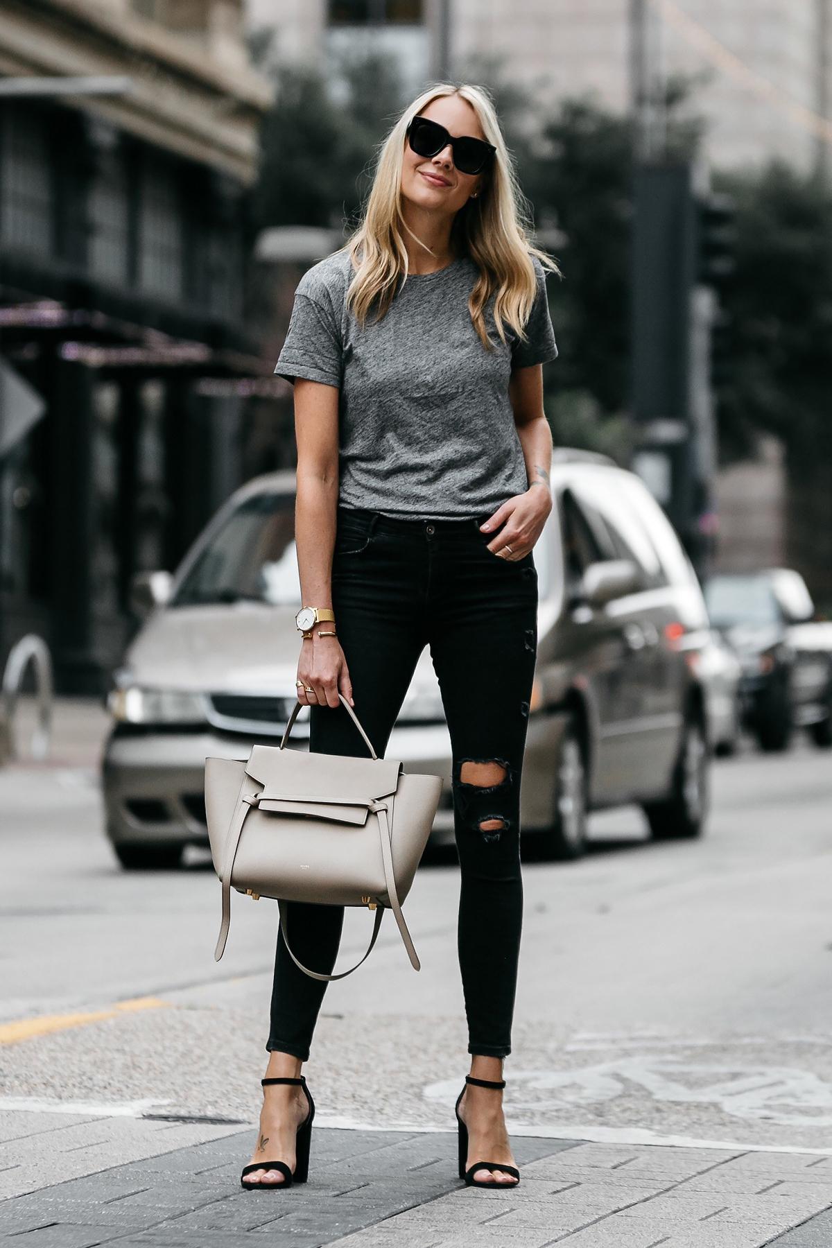 Blonde woman wearing Madewell grey tshirt zara black ripped skinny jeans outfit steve madden black ankle strap heels celine belt bag street style dallas blogger fashion blogger
