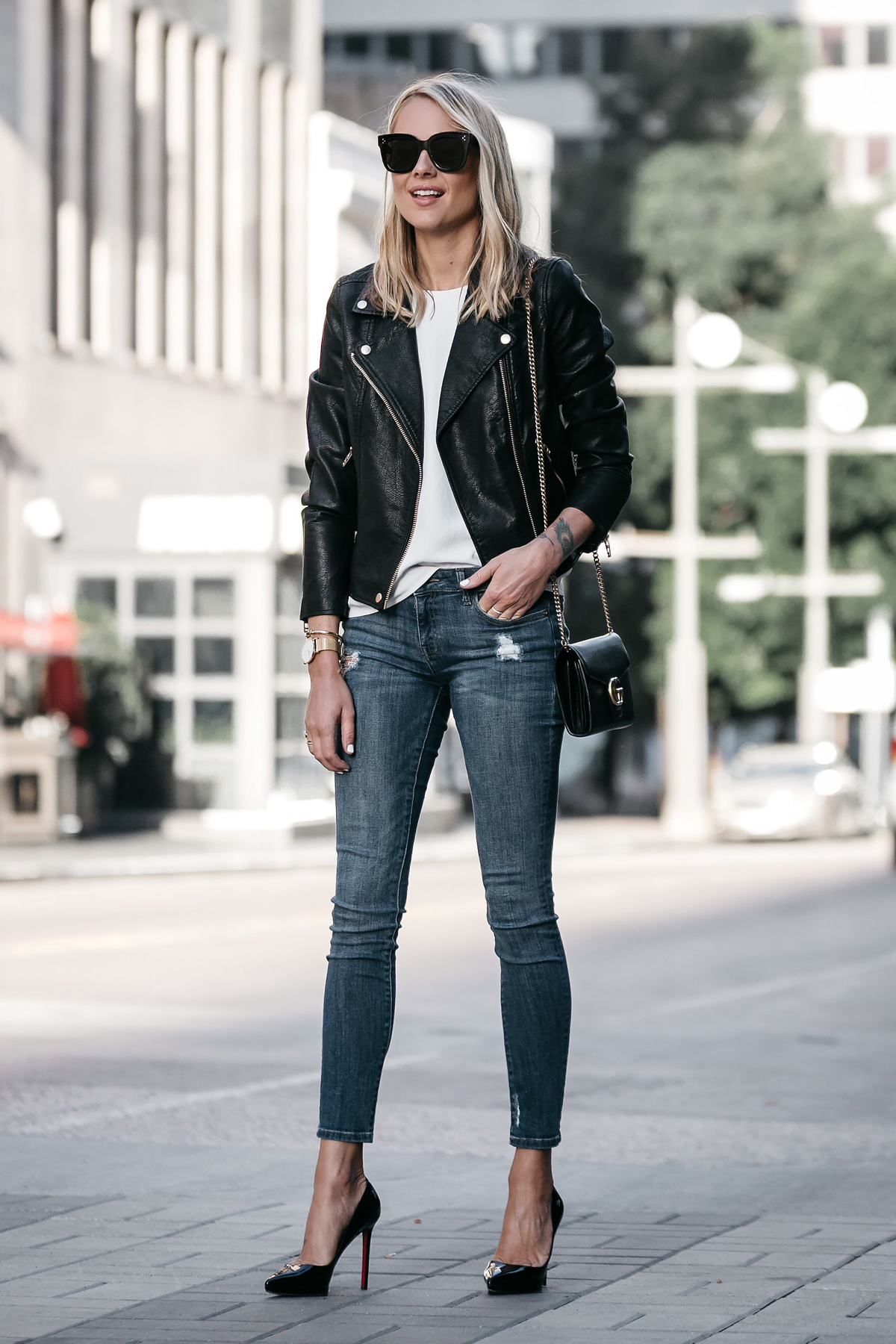 Blonde Woman Wearing Nordstrom Anniversary Sale Black Leather Moto Jacket Denim Skinny Jeans Christian Louboutin Black Pumps Fashion Jackson Dallas Blogger Fashion Blogger