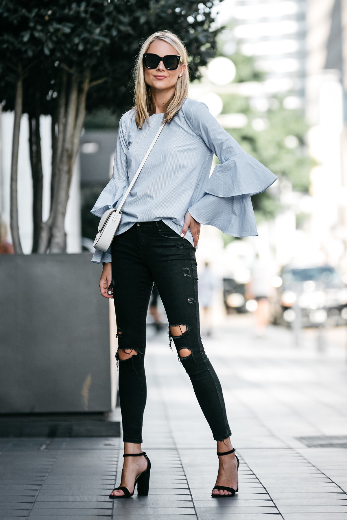 Blonde Woman Wearing Nordstrom Blue Bell Sleeve Top Black Ripped Skinny Jeans Outfit Celine Trotteur White Crossbody Black Heeled Sandals Fashion Jackson Dallas Blogger Fashion Blogger Street Style