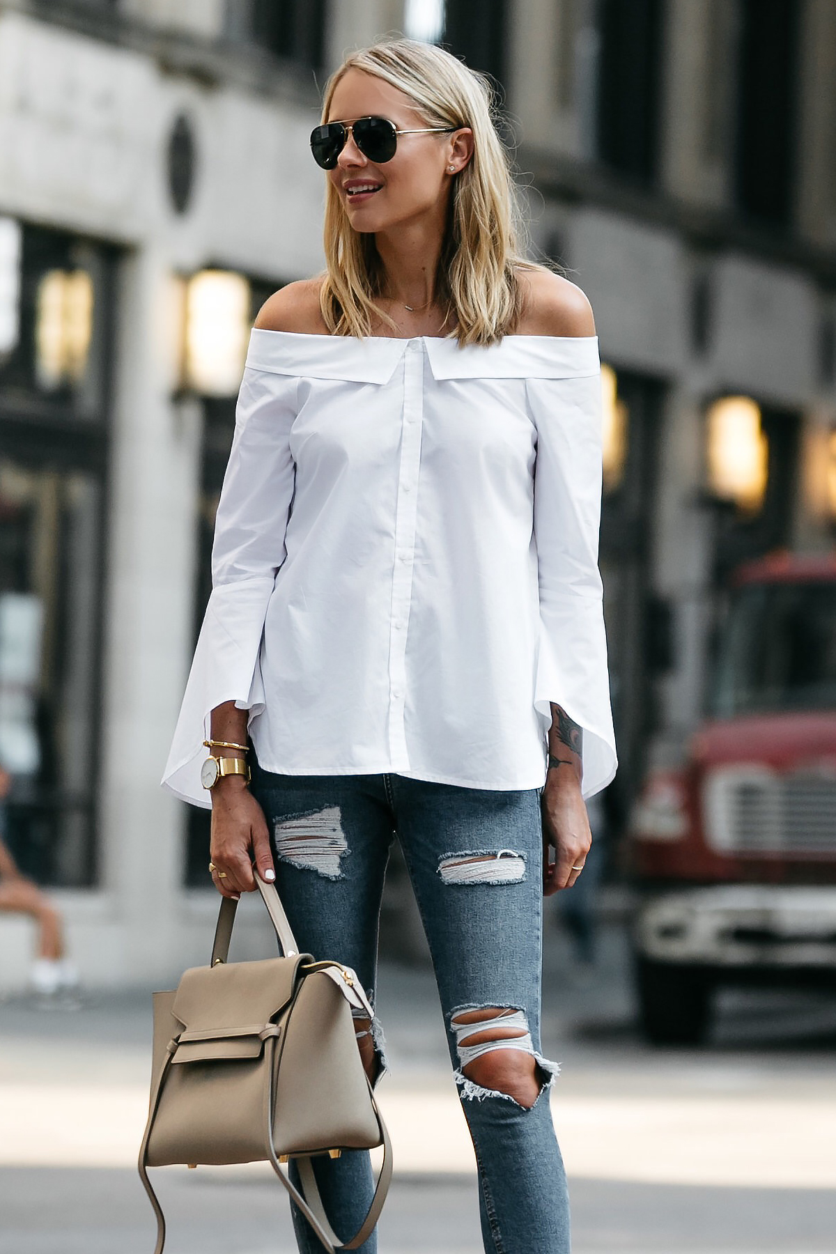 Blonde Woman Wearing Nordstrom Anniversary Sale White Bell-Sleeve off-the-shoulder Top Topshop Denim Ripped Skinny Jeans Outfit Celine Belt Bag Celine Aviator Sunglasses Fashion Jackson Dallas Blogger Fashion Blogger Street Style