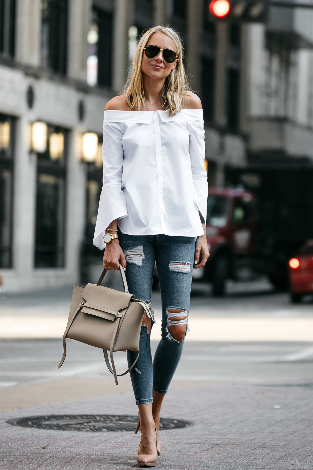 Blonde Woman Wearing Nordstrom Anniversary Sale White Bell-Sleeve off-the-shoulder Top Topshop Denim Ripped Skinny Outfit Jeans Christian Louboutin Nude Pumps Celine Belt Bag Celine Aviator Sunglasses Fashion Jackson Dallas Blogger Fashion Blogger Street Style
