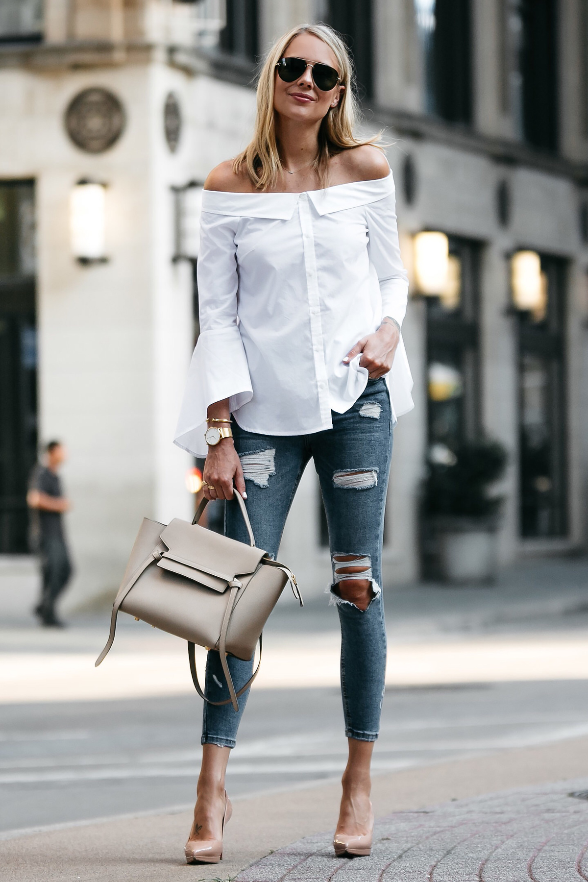 Blonde Woman Wearing Nordstrom Anniversary Sale White Bell-Sleeve off-the-shoulder Top Topshop Denim Ripped Skinny Jeans Outfit Christian Louboutin Nude Pumps Celine Belt Bag Celine Aviator Sunglasses Fashion Jackson Dallas Blogger Fashion Blogger Street Style