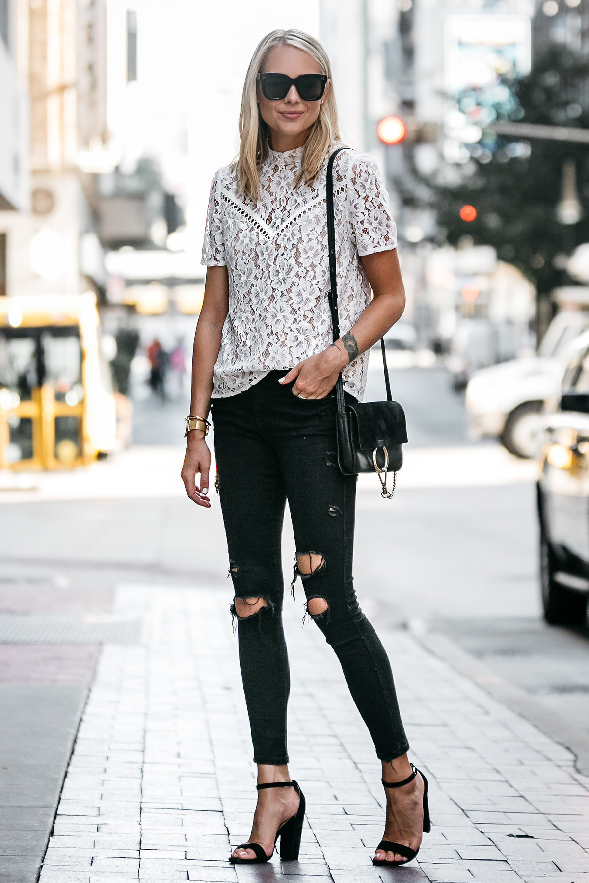 39111a73ce2 Blonde Woman Wearing Nordstrom Anniversary Sale White Lace Top Zara Black Ripped  Skinny Jeans Outfit Black