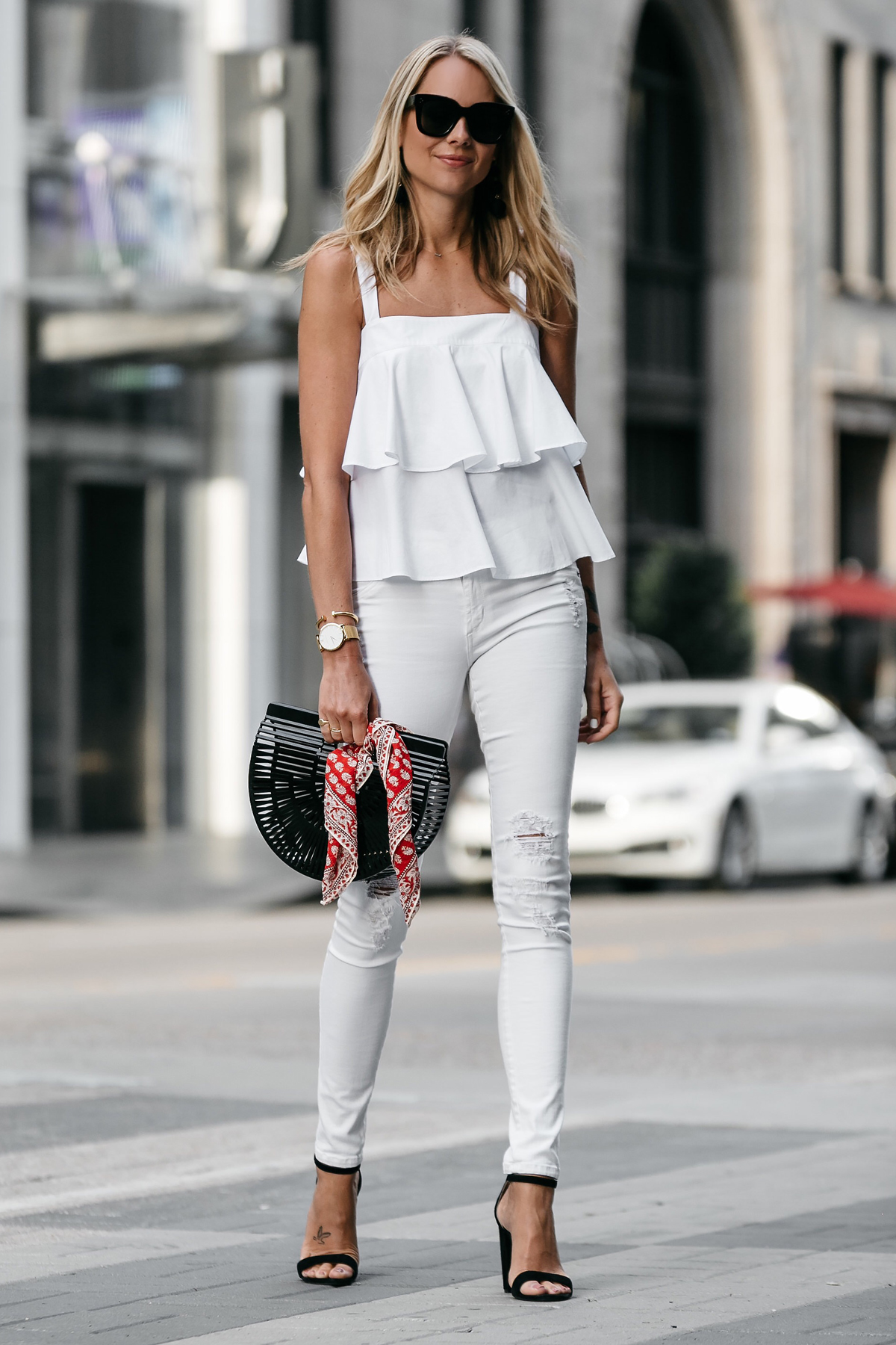 Blonde Woman Wearing Nordstrom White Ruffle Tank White Ripped Skinny Jeans Outfit Black Ankle Strap Heeled Sandals Cult Gaia Black Acrylic Clutch Red Bandana Fashion Jackson Dallas Blogger Fashion Blogger Street Style